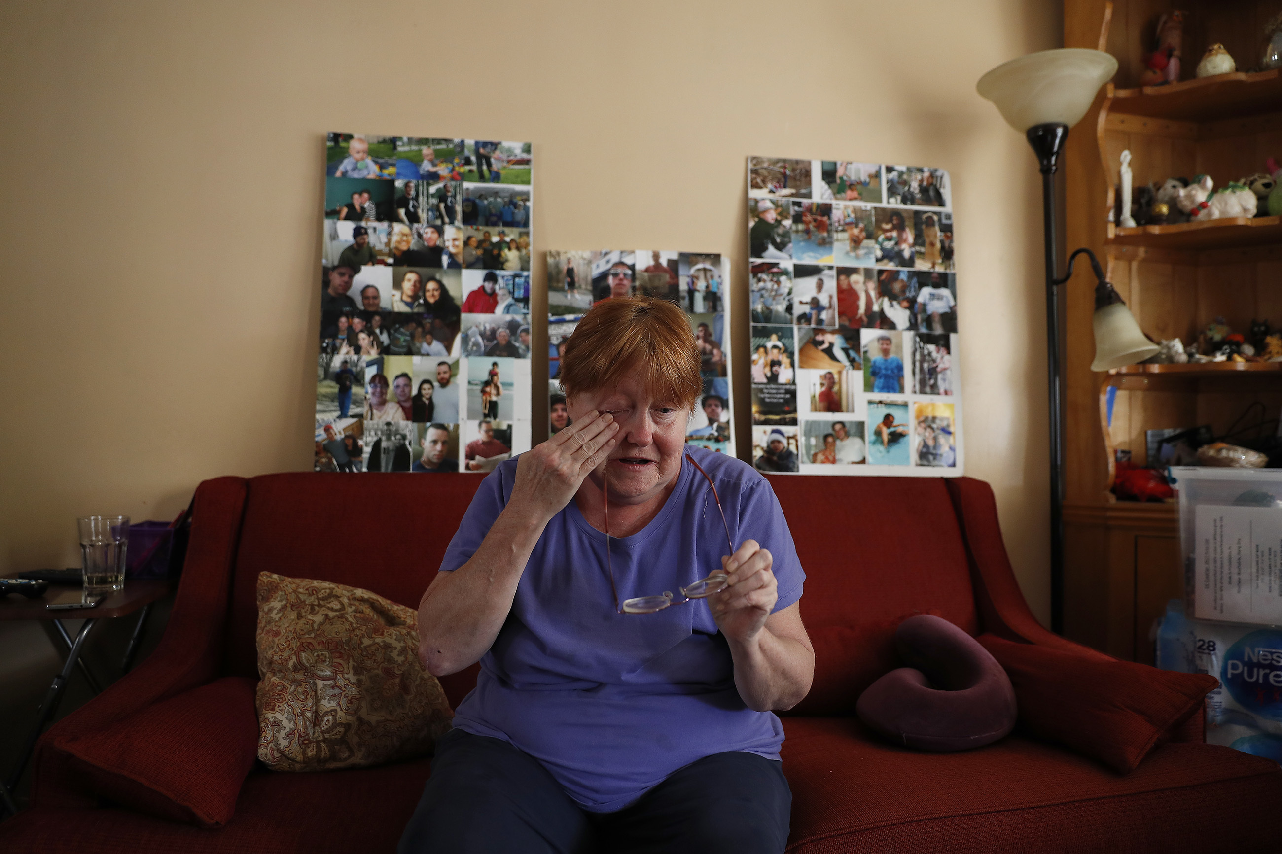 Kathleen Deacy Moore wipes away a tear as she talks about her son, Gregory Moore, in her home. He died of a heroin overdose earlier this year.