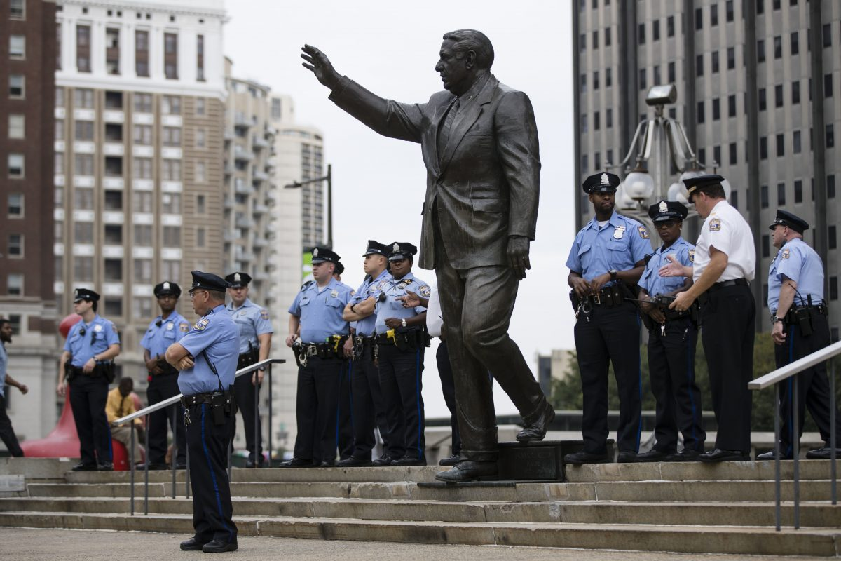 Police officers guard a statue of former Philadelphia mayor and police commissioner Frank Rizzo in Philadelphia, Thursday, Sept. 14, 2017. The statue that has spurred protests and vandalism from critics who argue that his policies alienated minorities.