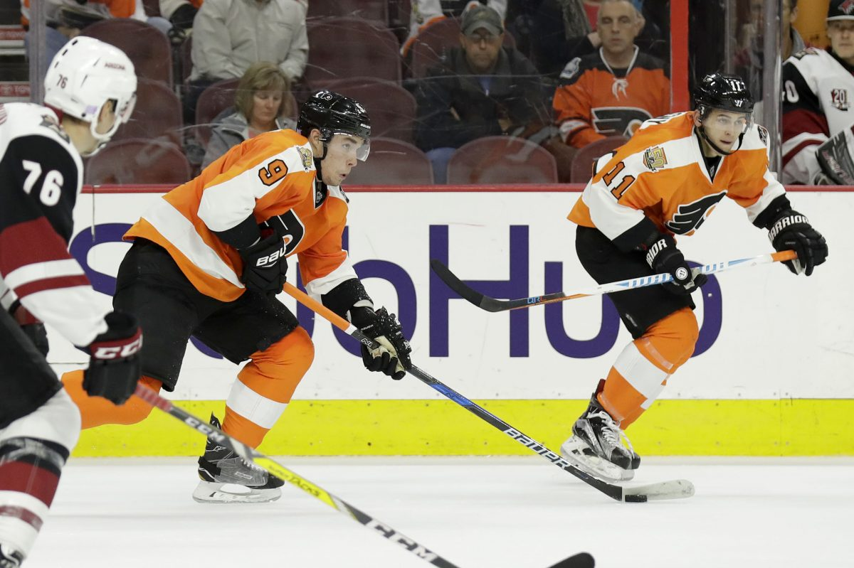 Flyers defenseman Ivan Provorov  (No. 9) skates with the puck while Travis Konecny heads down ice against Arizona last season. Both are hoping to build on strong rookie seasons.