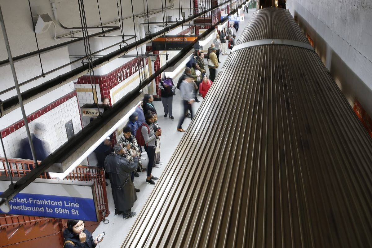 Commuters wait for the Broad Street line train at City Hall station DAVID MAIALETTI / Staff Photographer