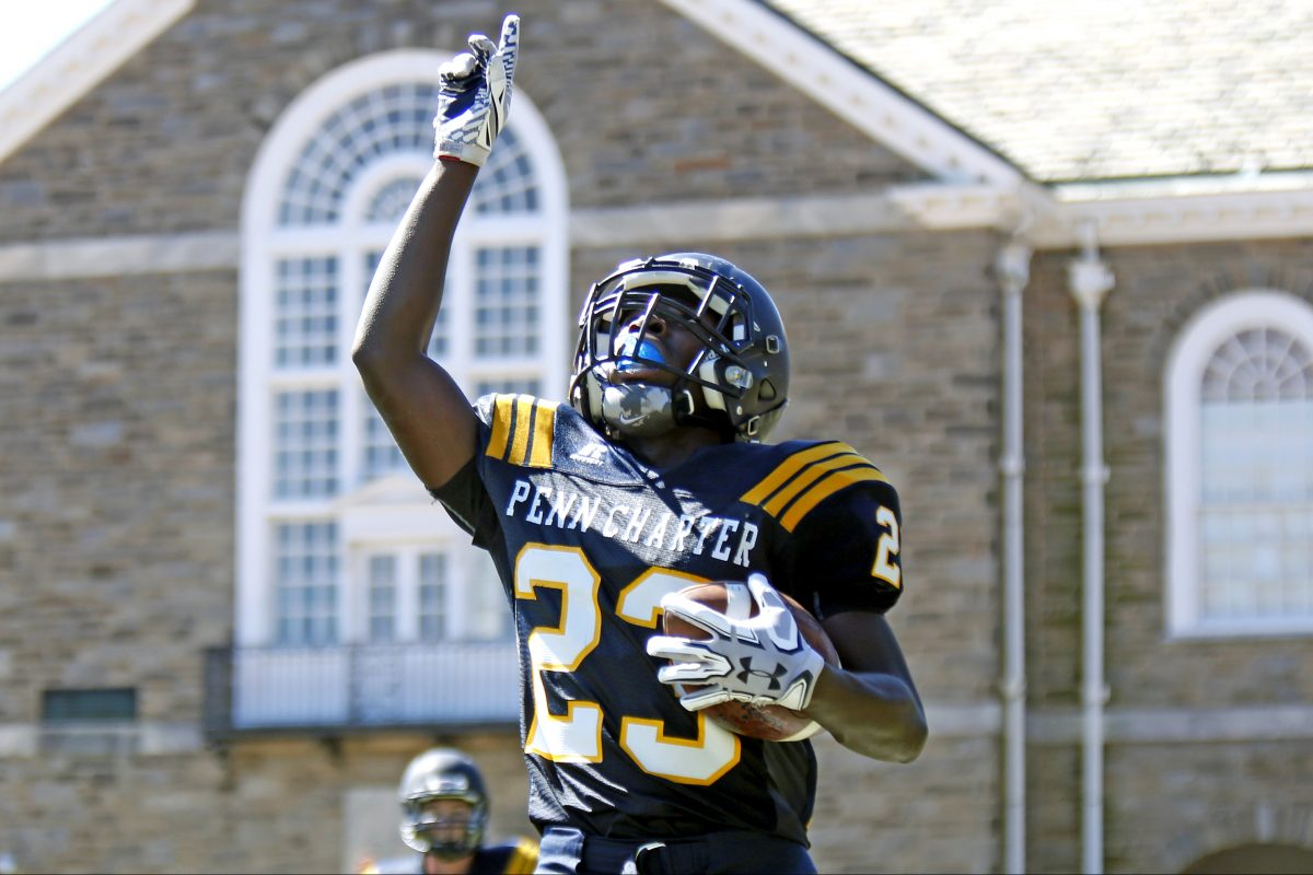 Penn Charter's John Washington points upward after he scores on a 53-yard punt return against Interboro in the second quarter of a nonleague football game on Saturday.