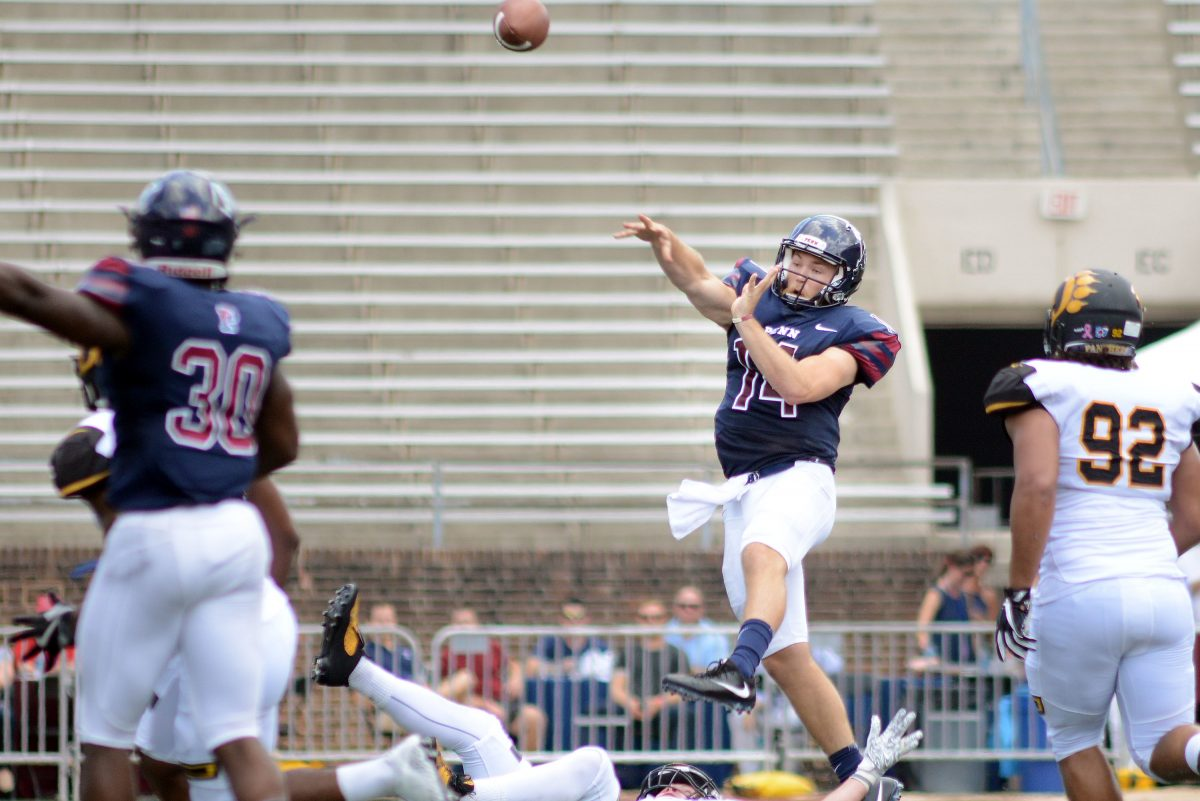Penn quarterback Will Fischer-Colbrie (14) makes a pass after almost getting sacked against Ohio Dominican in the second quarter Saturday, September 16, 2017 at Franklin Field in Philadelphia, Pennsylvania.