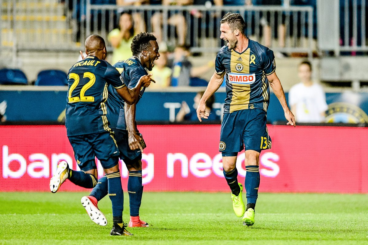 Chris Pontius (right) celebrates with Fafa Picault (left) and C.J. Sapong) center after scoring one of his two goals in the Philadelphia Union's 3-1 win over the Chicago Fire.
