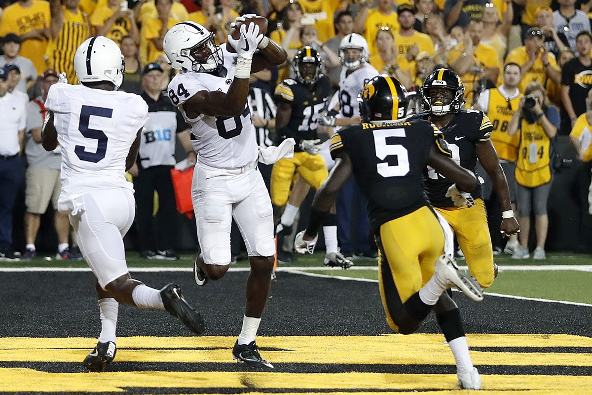 Penn State wide receiver Juwan Johnson (84) catches a touchdown pass between teammate DaeSean Hamilton, left, and Iowa defensive backs Manny Rugamba and Miles Taylor, right, as time expires in an NCAA college football game Saturday, Sept. 23, 2017, in Iowa City, Iowa.