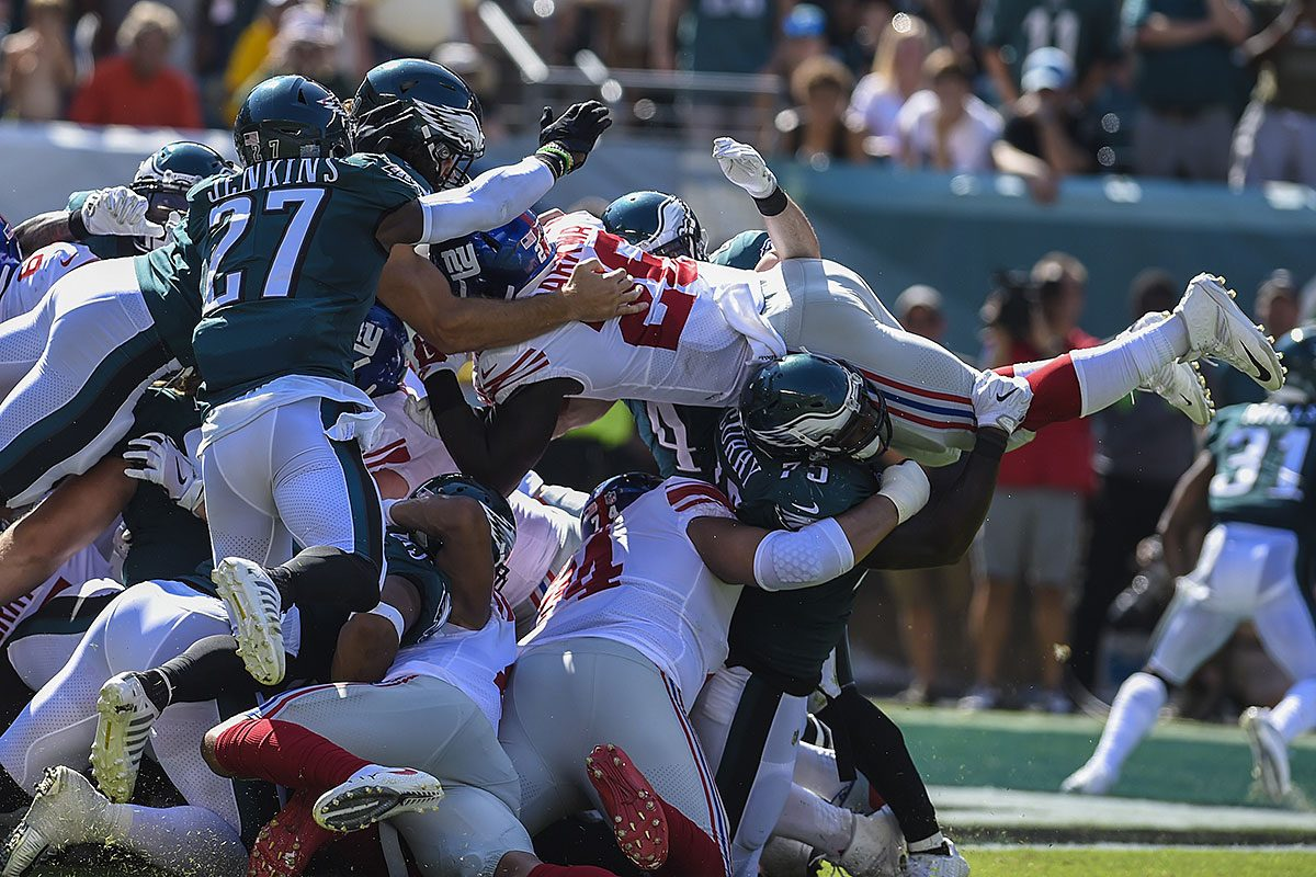 Giants running back Orleans Darkwa is stopped short of the goal line on by Eagles defensive end Vinnie Curry and his teammates.