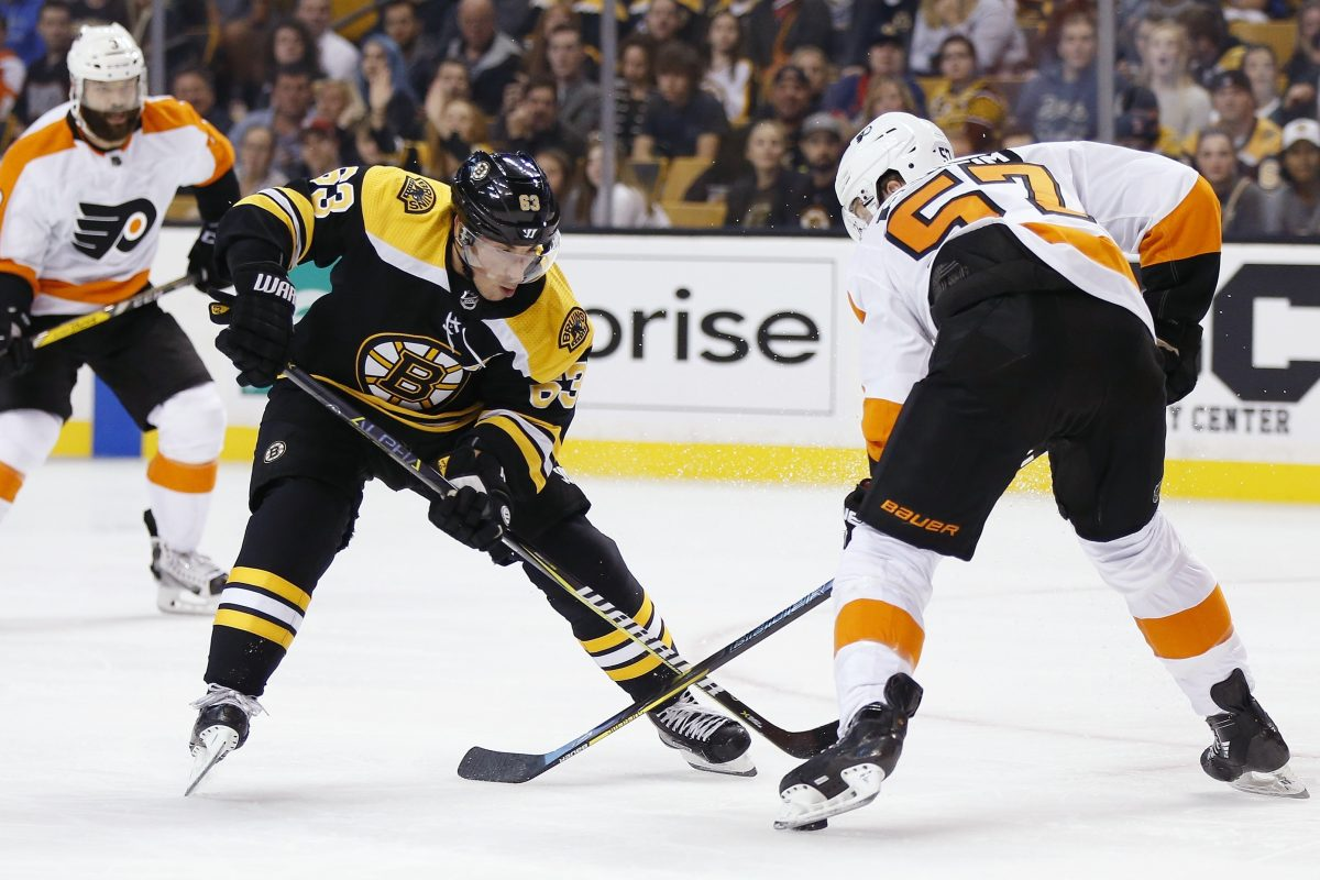 Brad Marchand (63), battling the Flyers' Travis Sanheim in Thursday's exhibition game, was outspoken about the stricter enforcement of faceoff and slashing violations in preseason games.