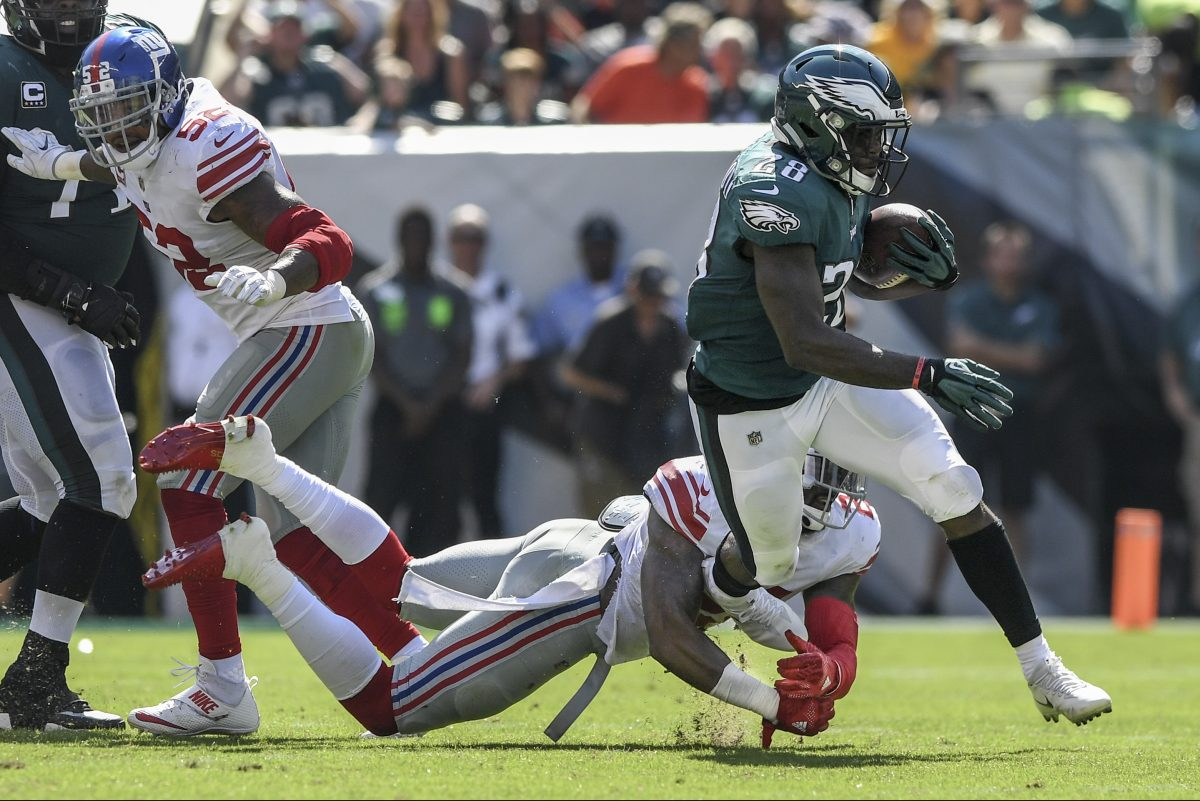 Eagles running back Wendell Smallwood fights off New York Giants safety Landon Collins in the Eagles' 27-24 win over the Giants on Sunday.