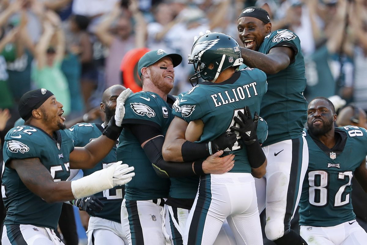 Eagles' Carson Wentz, second from left, and Alshon Jeffery, right, celebrate with Jake Elliott, center, after kicking the game winning field goal as the Philadelphia Eagles win 27-24 over the New York Giants in Philadelphia, PA on September 24, 2017. DAVID MAIALETTI / Staff Photographer