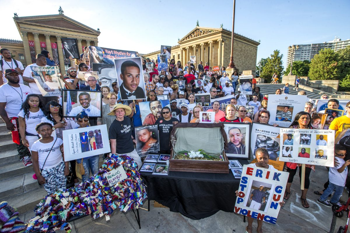 Relatives and friends of the victims of gun violence stand on the Art Museum steps on June 15, 2017. CHARLES FOX / Staff Photographer