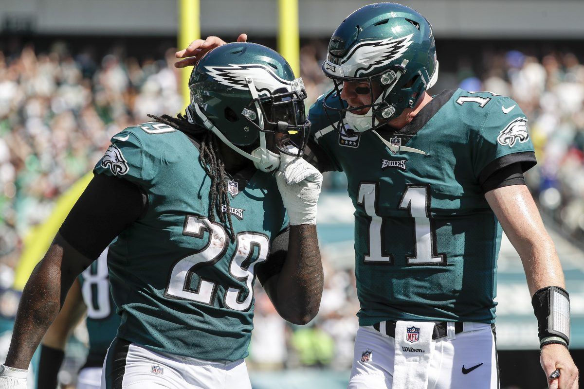 Eagles quarterback Carson Wentz chats with running back LeGarrette Blount during Sunday's game against the Giants.