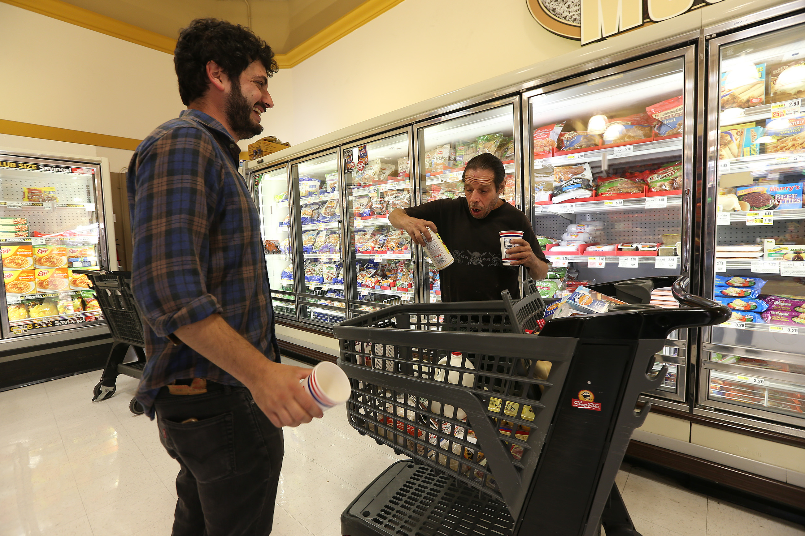 Gabriel Kalmuss-Katz, left, a social worker at Pathways to Housing PA, accompanies Anthony Messina grocery shopping before he moves into his new apartment on Sept. 11. (DAVID MAIALETTI / Staff Photographer)