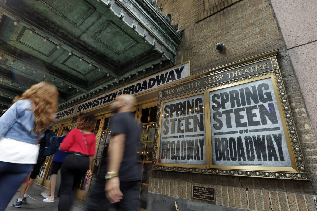 "People pass the Walter Kerr Theater, home to the Broadway show ""Springsteen on Broadway,"" in New York´s Theater District. The upcoming show will be the one of the latest to offer up tickets for sale using new technology, called Verified Fan, to try to keep re-sellers and brokers from snapping them all up."