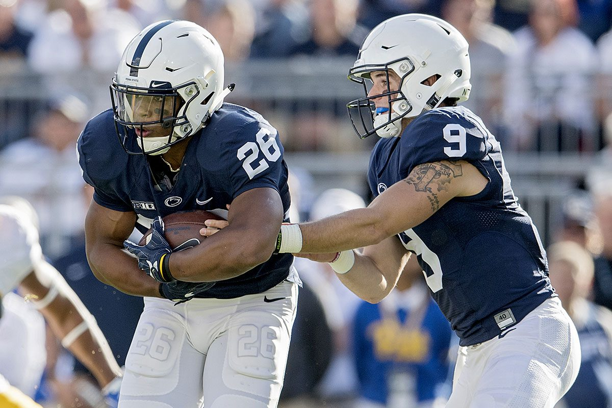 Penn State quarterback Trace McSorley (9) hands off to running back Saquon Barkley during action against Pitt on Saturday, Sept. 9, 2017, at Beaver Stadium in University Park, Pa. Penn State won, 33-14.