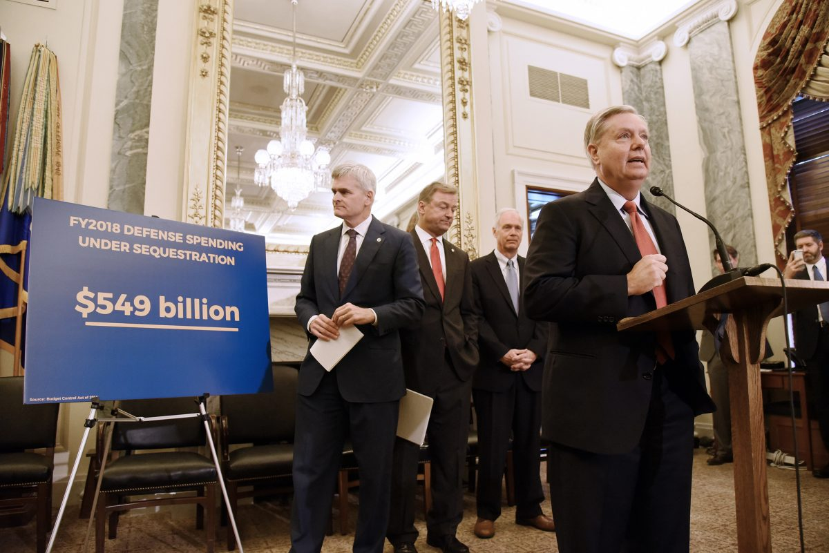 U.S. Sen. Lindsey Graham (R., S.C.) speaks as Sen. Bill Cassidy (R., La.), Sen. Dean Heller (R., Nev.), and Sen. Ron Johnson (R., Wis.) listen during a Sept. 13 news conference on health care on Capitol Hill in Washington.