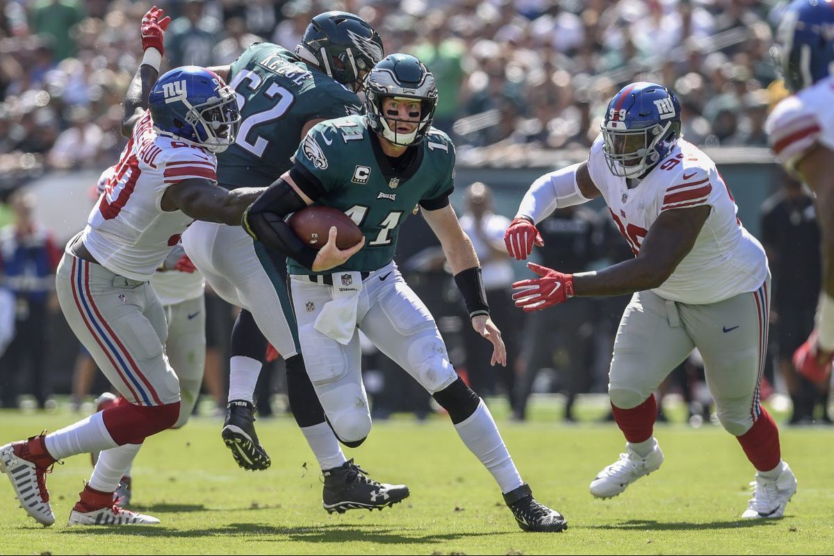 Carson Wentz scrambles against the Giants in the Eagles' 27-24 win on Sunday.