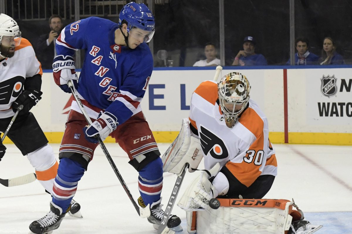 Flyers goalie Michal Neuvirth deflects a shot by Rangers left winger Matt Puempel during the second period.