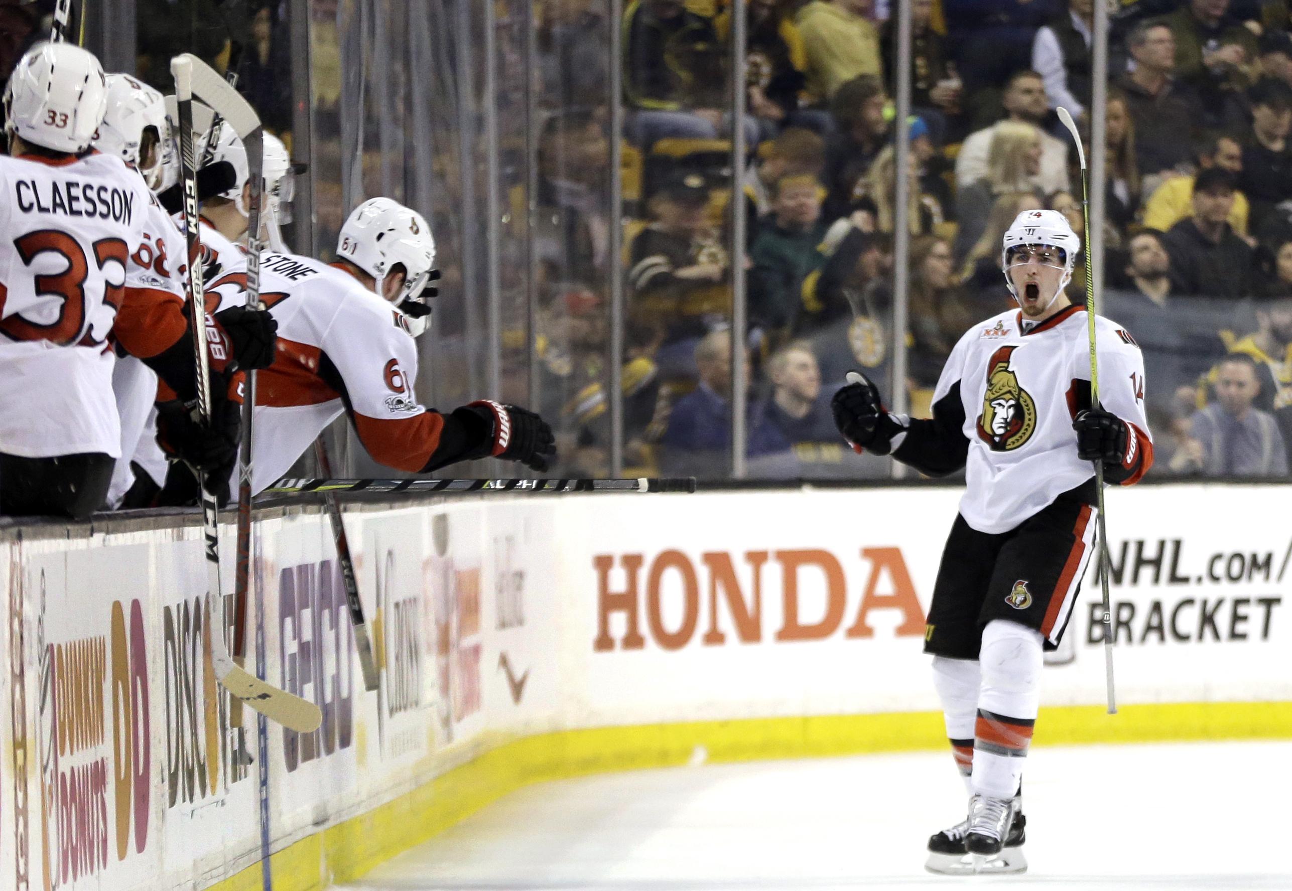 Ottawa Senators left wing Alexandre Burrows (14) celebrates his goal against the Boston Bruins during the second period of an NHL hockey game, Thursday, April 6, 2017, in Boston. (AP Photo/Elise Amendola)