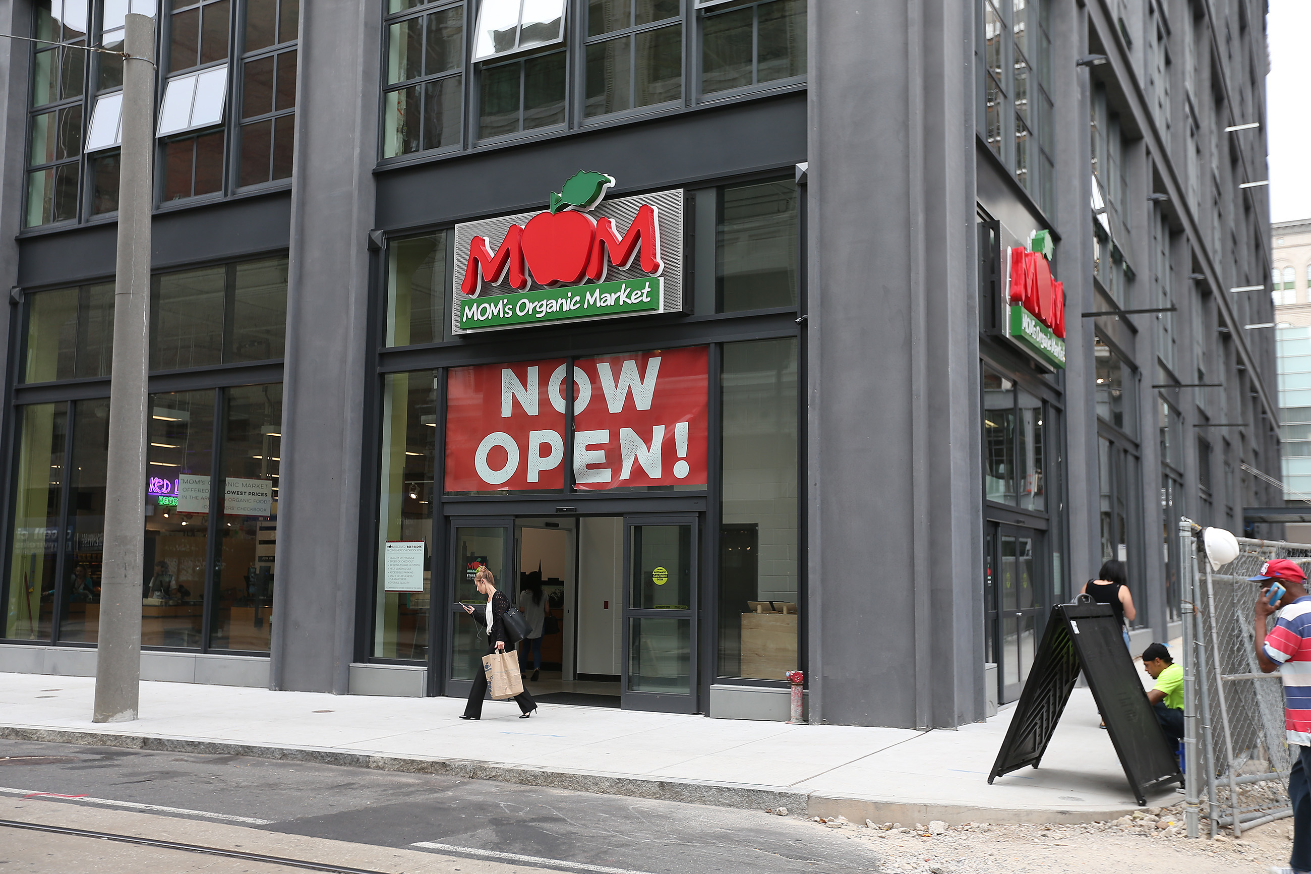 A shopper exits MOM's Organic Market which opened Sept. 8 at East Market.