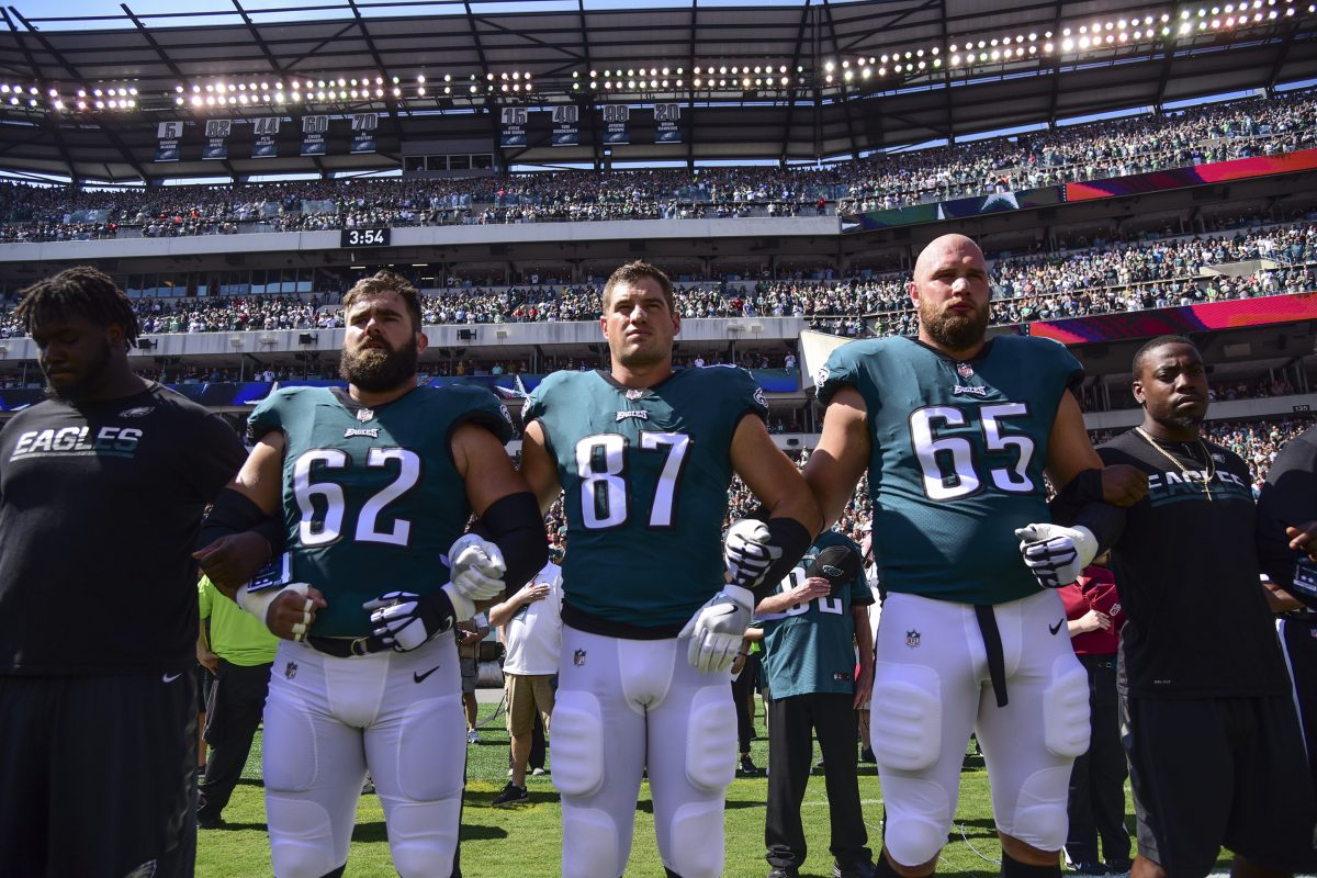 Eagles players Jason Kelce (left), Brent Celek and Lane Johnson hook arms during the playing of the national anthem before the game against the Giants at Lincoln Financial Field September 24, 2017. The Eagles won 27-24.