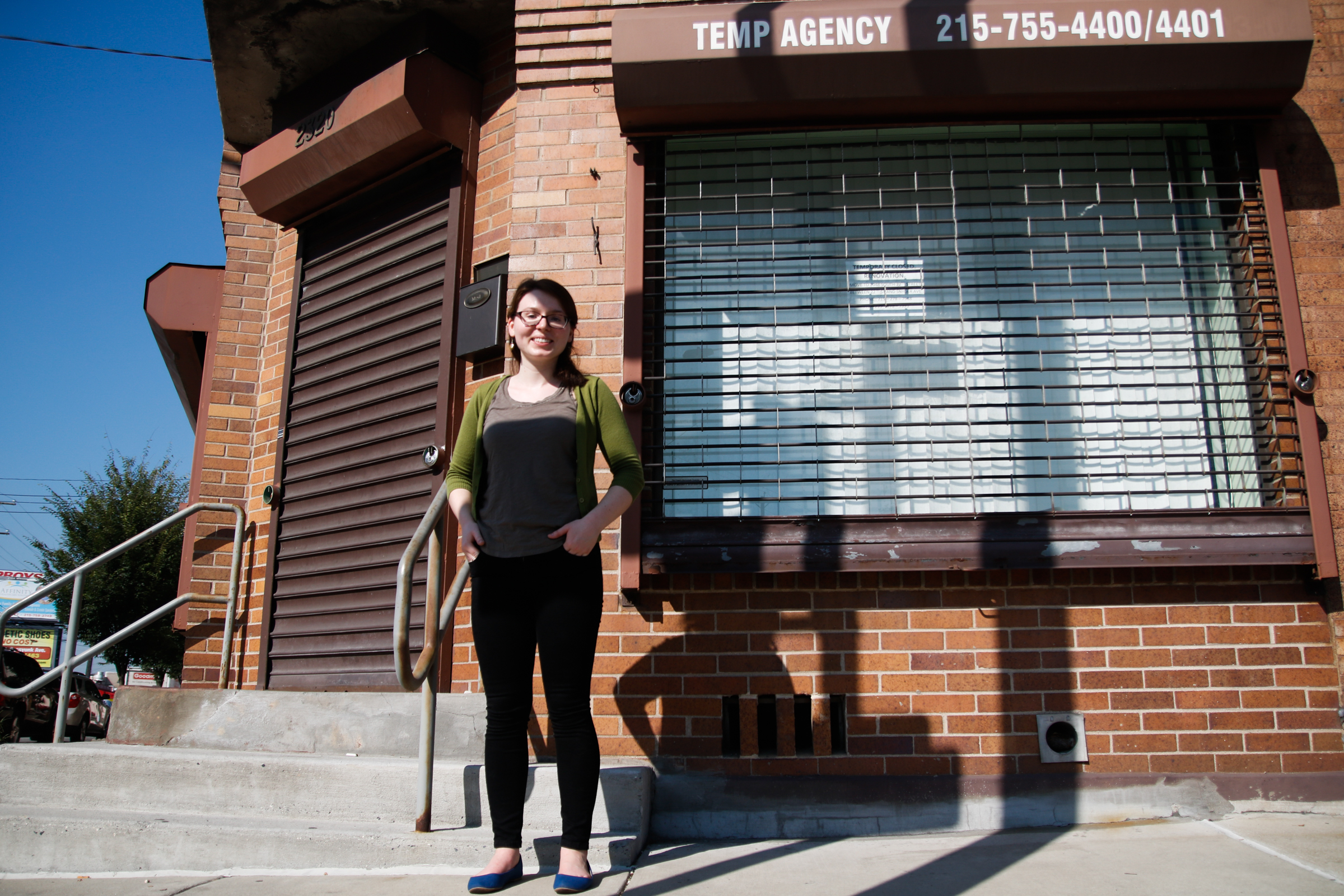 Researcher Rebecca Daily poses for a photo outside a temp agency in South Philadelphia. KAIT MOORE / Staff Photographer
