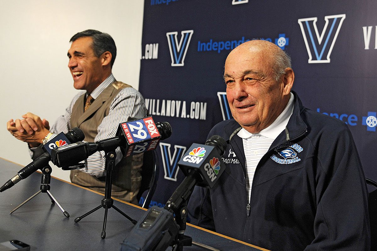 Villanova basketball coach Jay Wright, left, cracks up as former Villanova coach Rollie Massimino tells a joke at a news conference on November 4, 2014.