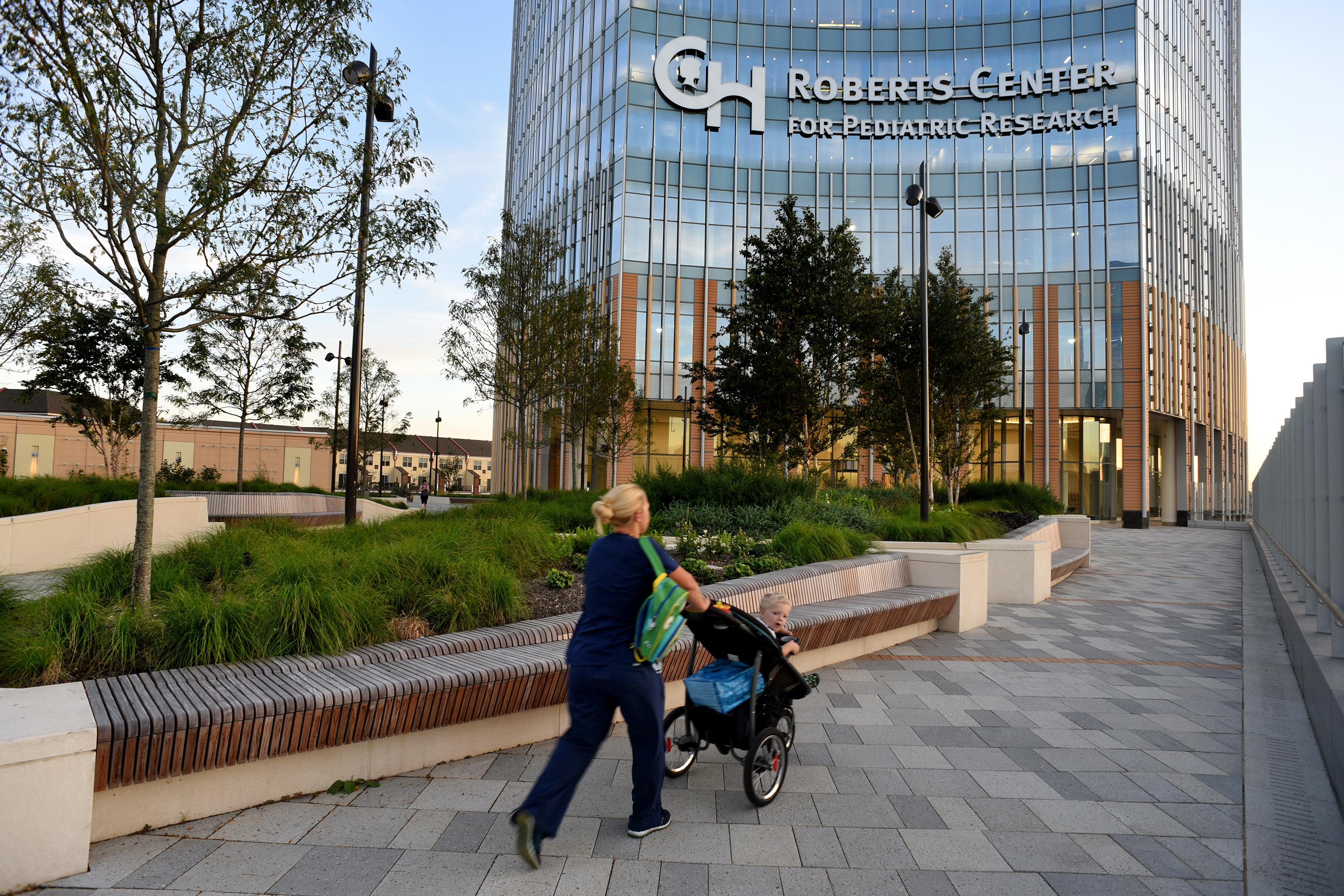 The entrance plaza at the Roberts Center for Pediatric Research is overwhelmed by large planters.