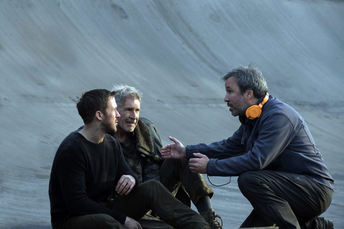 "Ryan Gosling (from left), Harrison Ford, and director Denis Villenueve on the set of ""Blade Runner 2049."""