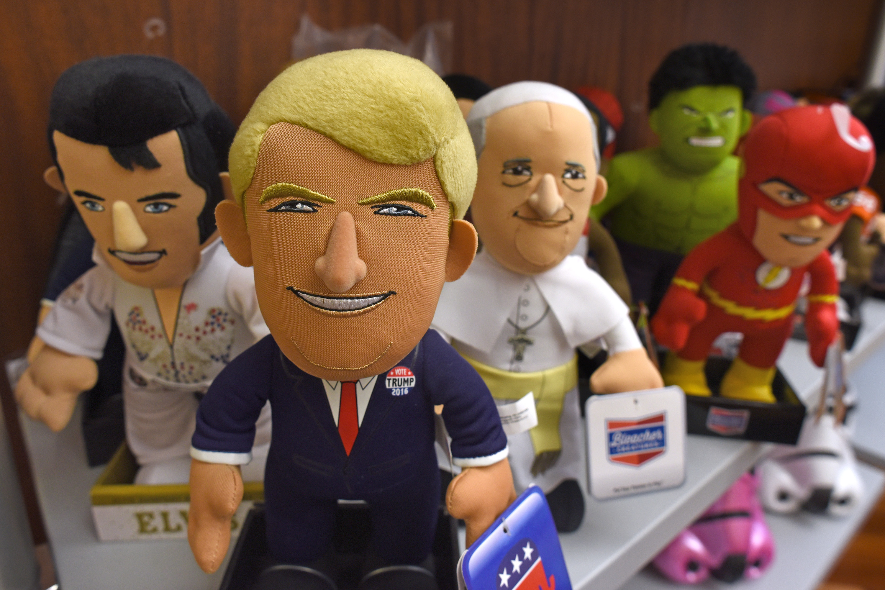 Elvis (from left), President Donald Trump, Pope Francis and some super hero 10-inch plush dolls created by Plymouth Township-based Bleacher Creatures on display at Pangea Brands in New York September 28, 2017. Bleacher Creatures has emerged from bankruptcy with a new ownership and business structure, with a new name, Uncanny Brands. It is the result of its purchase by New York-based Pangea, known for its multi-brand pop-culture toys, appliances (including Star Wars waffle irons and toasters). Bleacher Creatures´ founder Matthew Hoffman will be president of the new business and is finally, after more than six years in business, having fun. TOM GRALISH / Staff Photographer