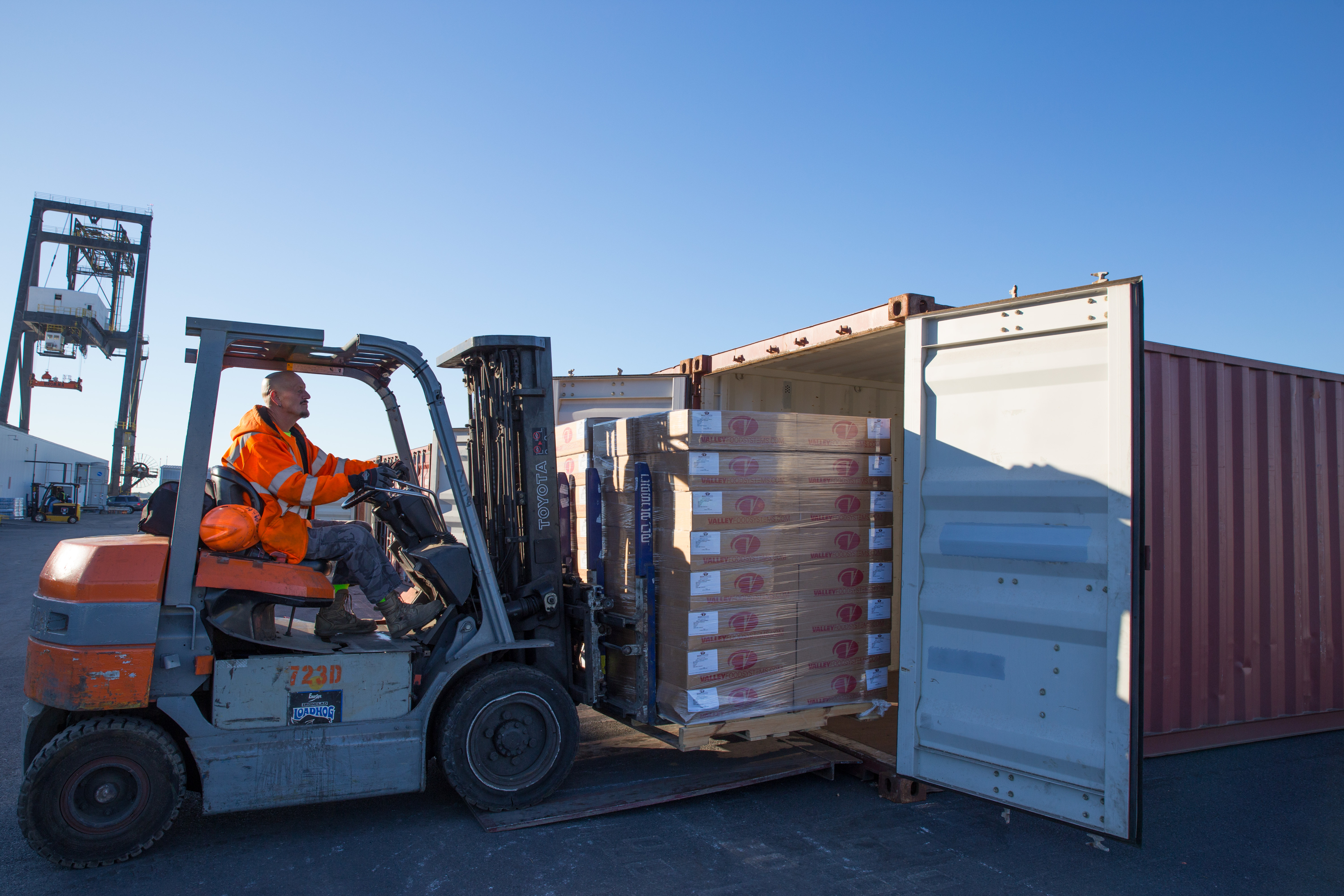 Steven Trautz loads supplies into a shipping container headed for Puerto Rico from Penn Terminals. JESSICA GRIFFIN / Staff Photographer