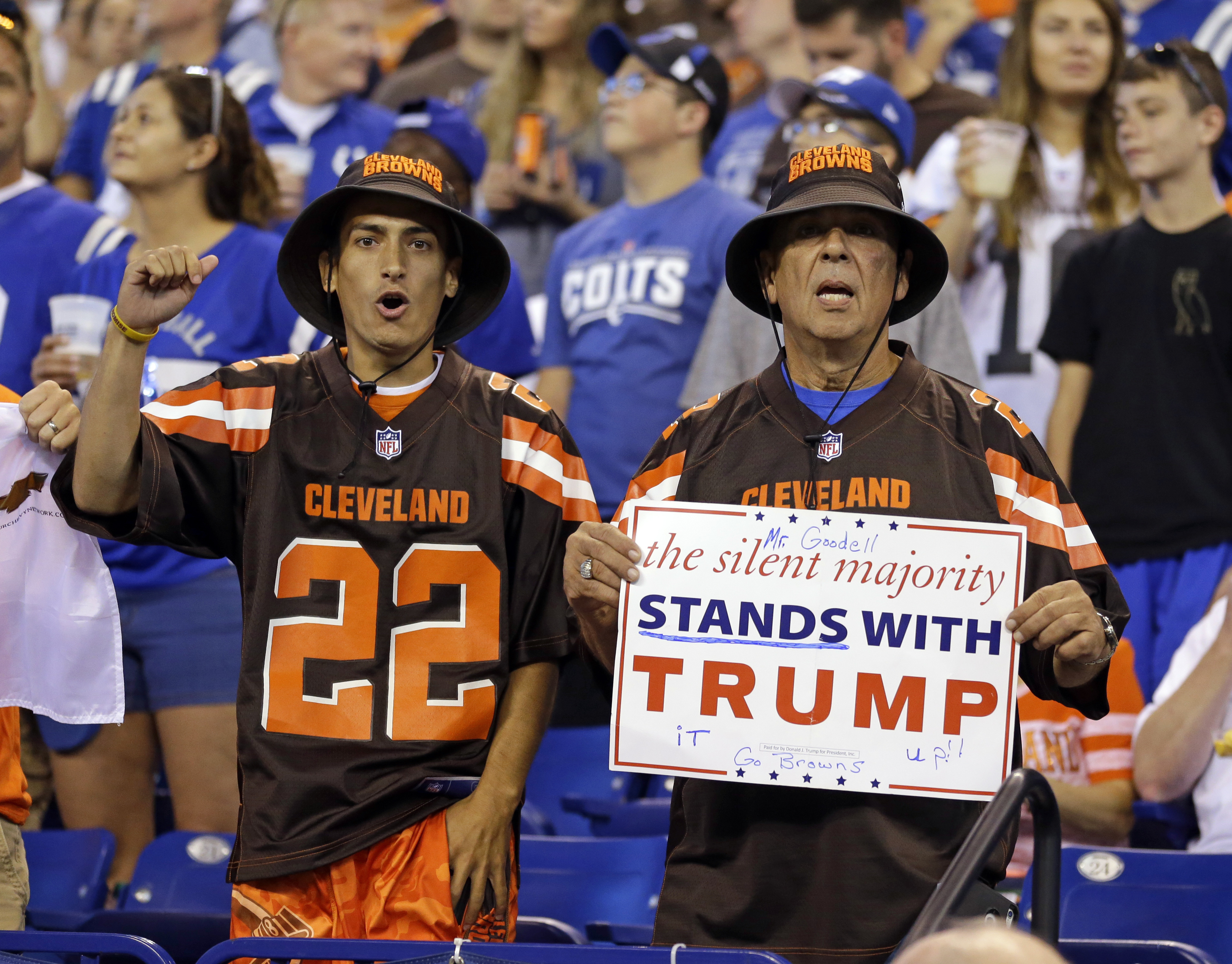 Cleveland Browns fans show their allegiance to President Trump on an issue that started last season when former San Francisco quarterback Colin Kaepernick took a knee to protest social injustice. (AP Photo/Michael Conroy, File)