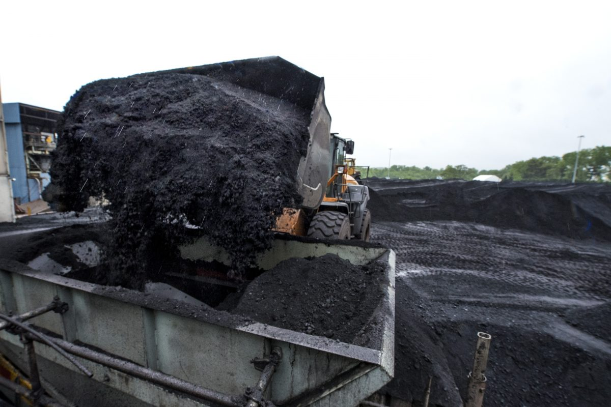 A mountain of coal is being removed from the Mercer Generation Station as part of its shut-down. CLEM MURRAY / Staff Photographer