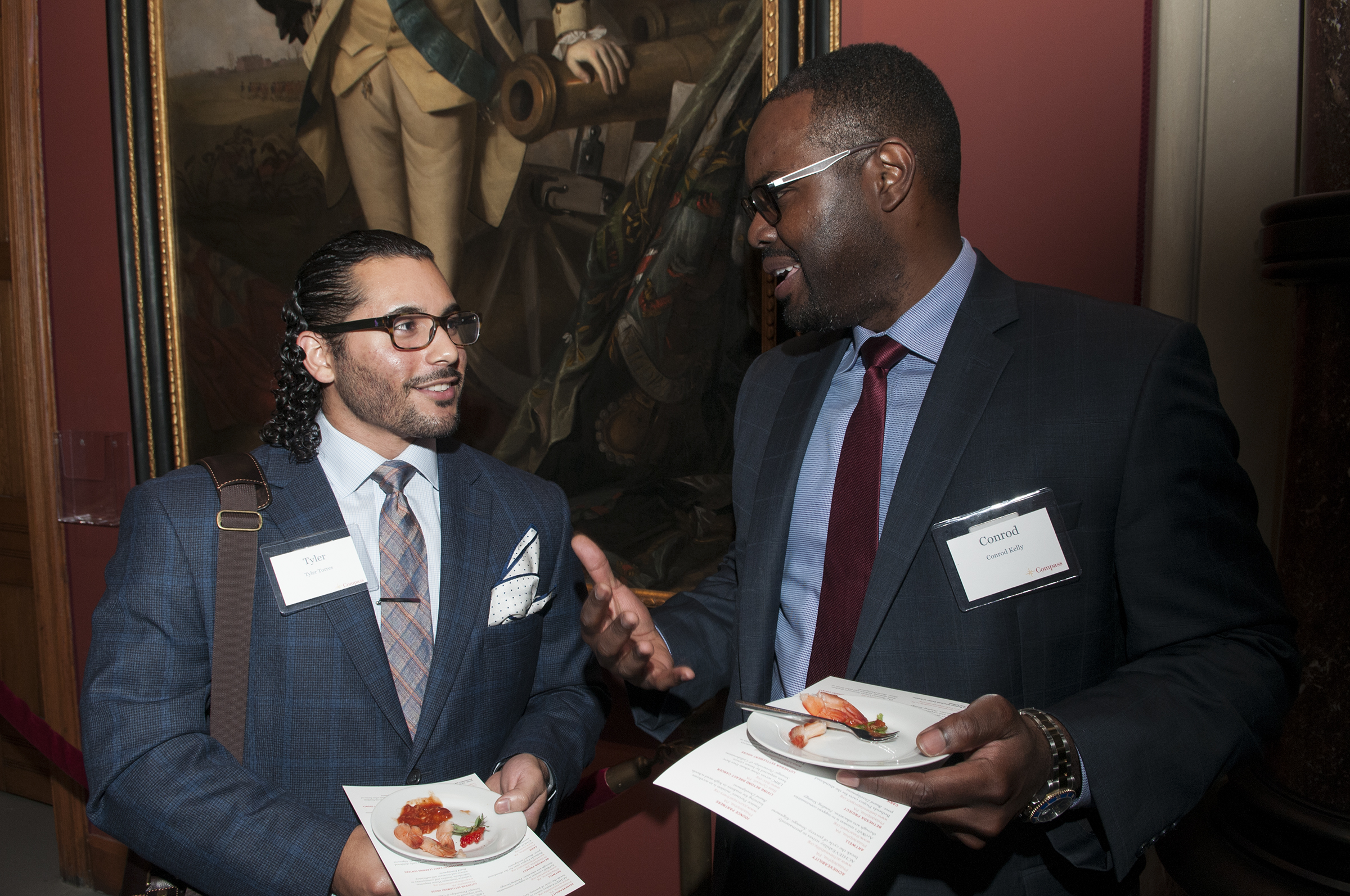 Tyler Torres (left) attended Compass´ Project Launch at the Pennsylvania Academy of Fine Arts on Sept. 28, hoping he is selected as a Compass volunteer for the 2017-18 project cycle. He´s talking with another attendee, Conrod Kell at the meet-and-greet event.networking event. ( RAYMOND W HOLMAN JR / For the Inquirer )