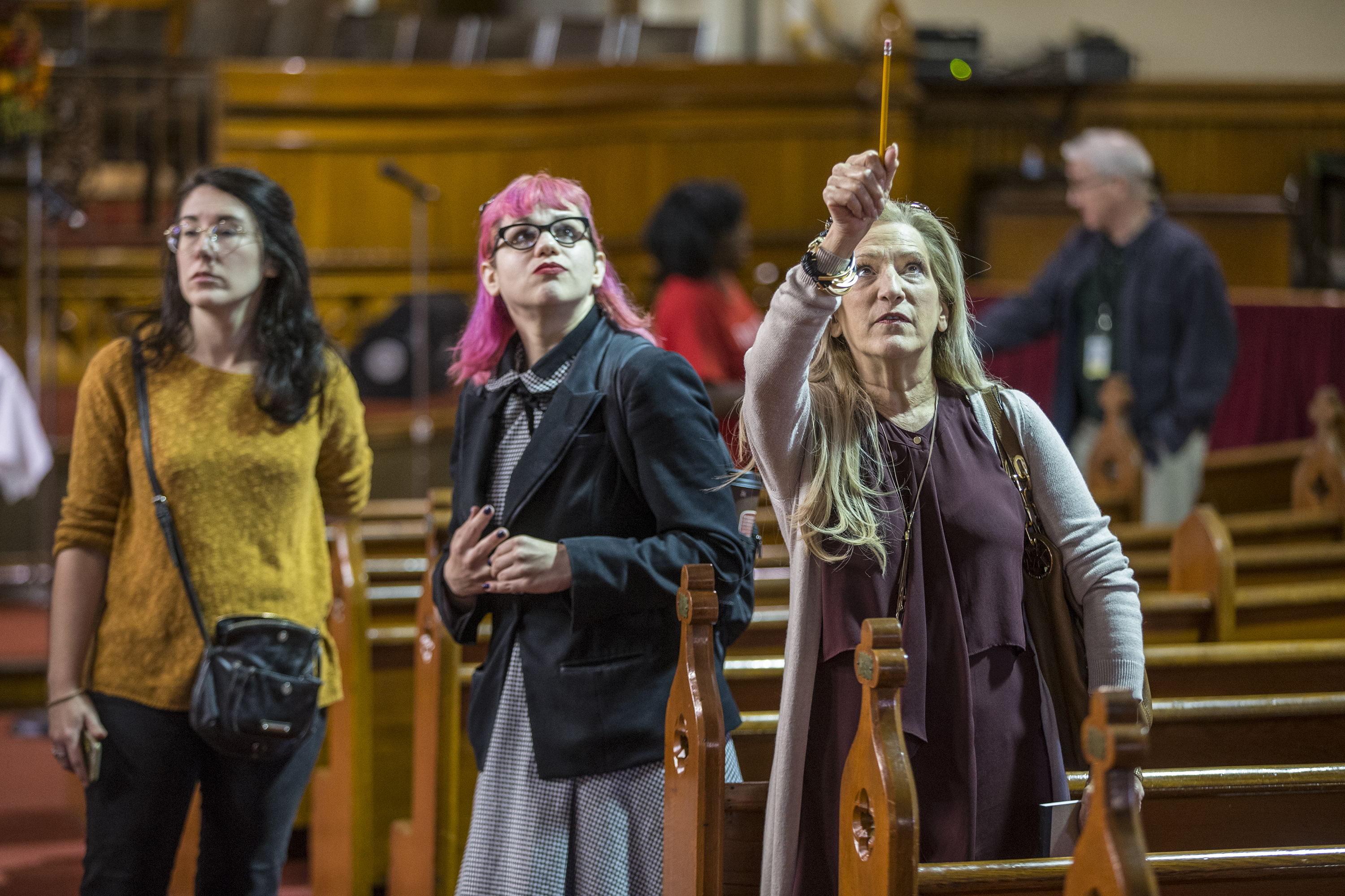 Denise Davis, right, looks up at the stained glass windows in the Tabernacle of Faith Church in the 400 block of Cooper Street that was part of a tour Sunday sponsored by the Rutgers-Camden Center for the Arts and the Mid-Atlantic Center for the Humanities.