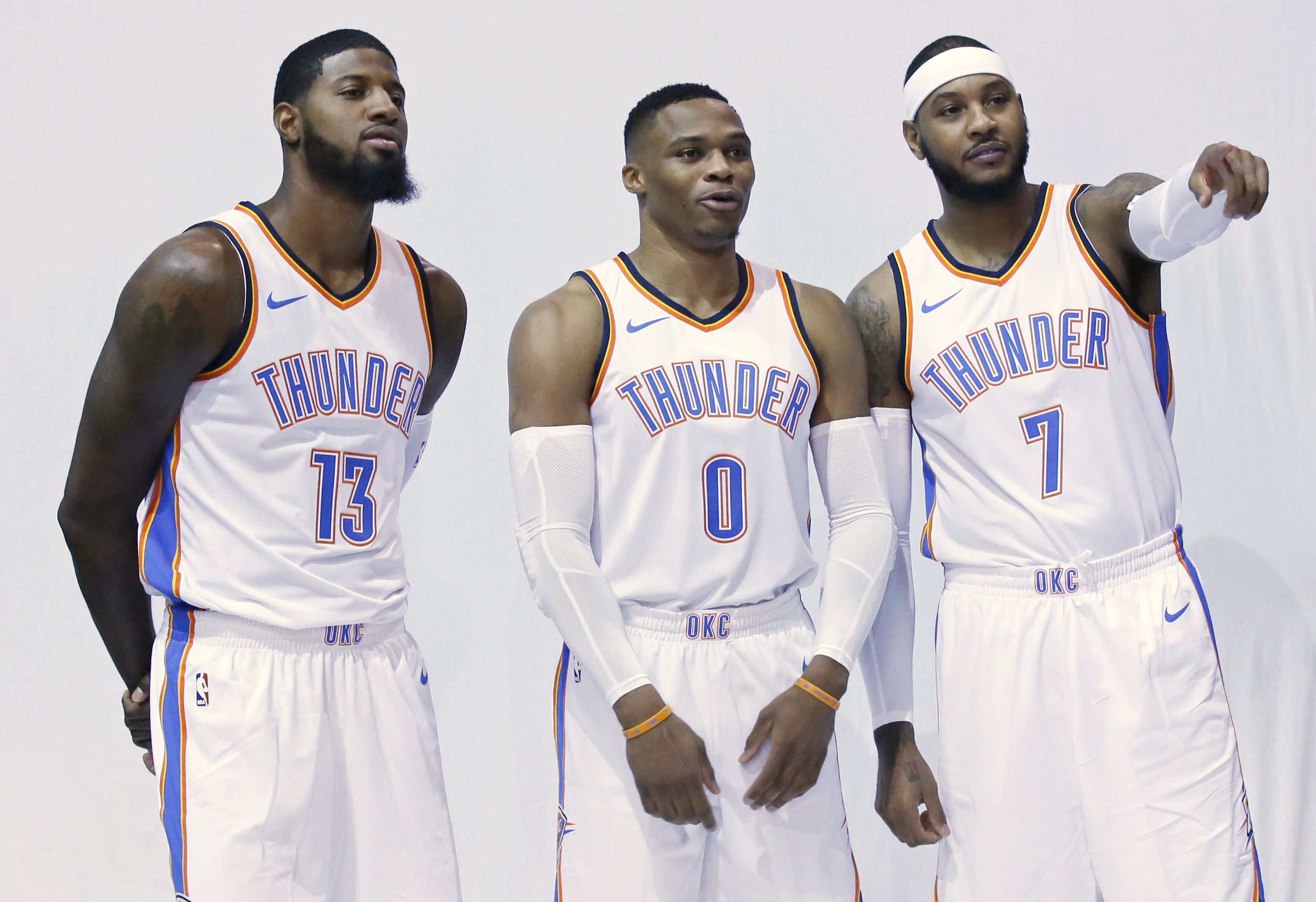 Oklahoma City Thunder´s Paul George (13), Russell Westbrook (0) and Carmelo Anthony (7) pose for photos during an NBA basketball media day in Oklahoma City, Monday, Sept. 25, 2017. (AP Photo/Sue Ogrocki)