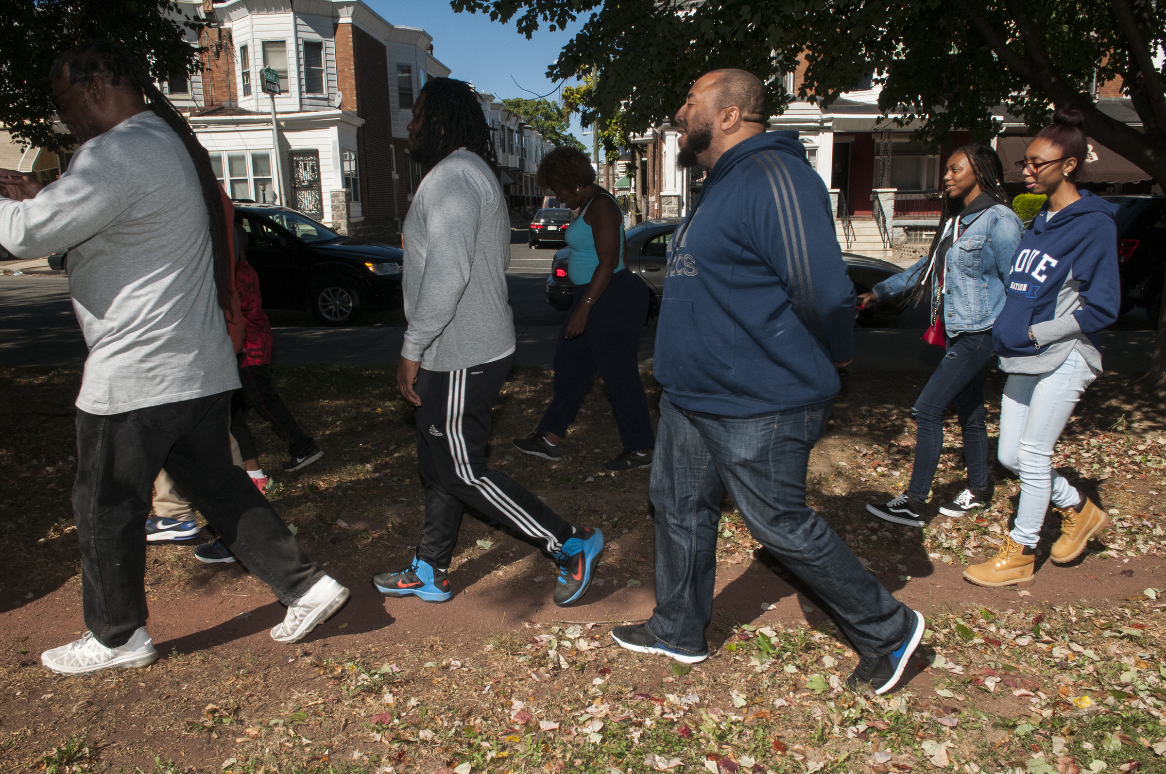 Men and members of the Block by Block Black Captains exercising in Carroll Park. (RAYMOND W HOLMAN JR / For the Philadelphia Inquirer )
