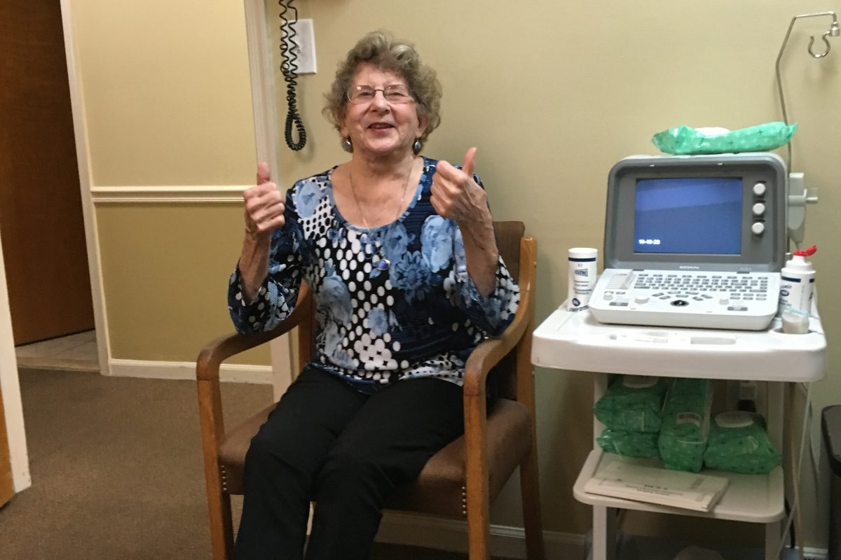 Milli Burke, 84, gives thumbs-up before a stem cell procedure she hopes will help her arthritic knees.
