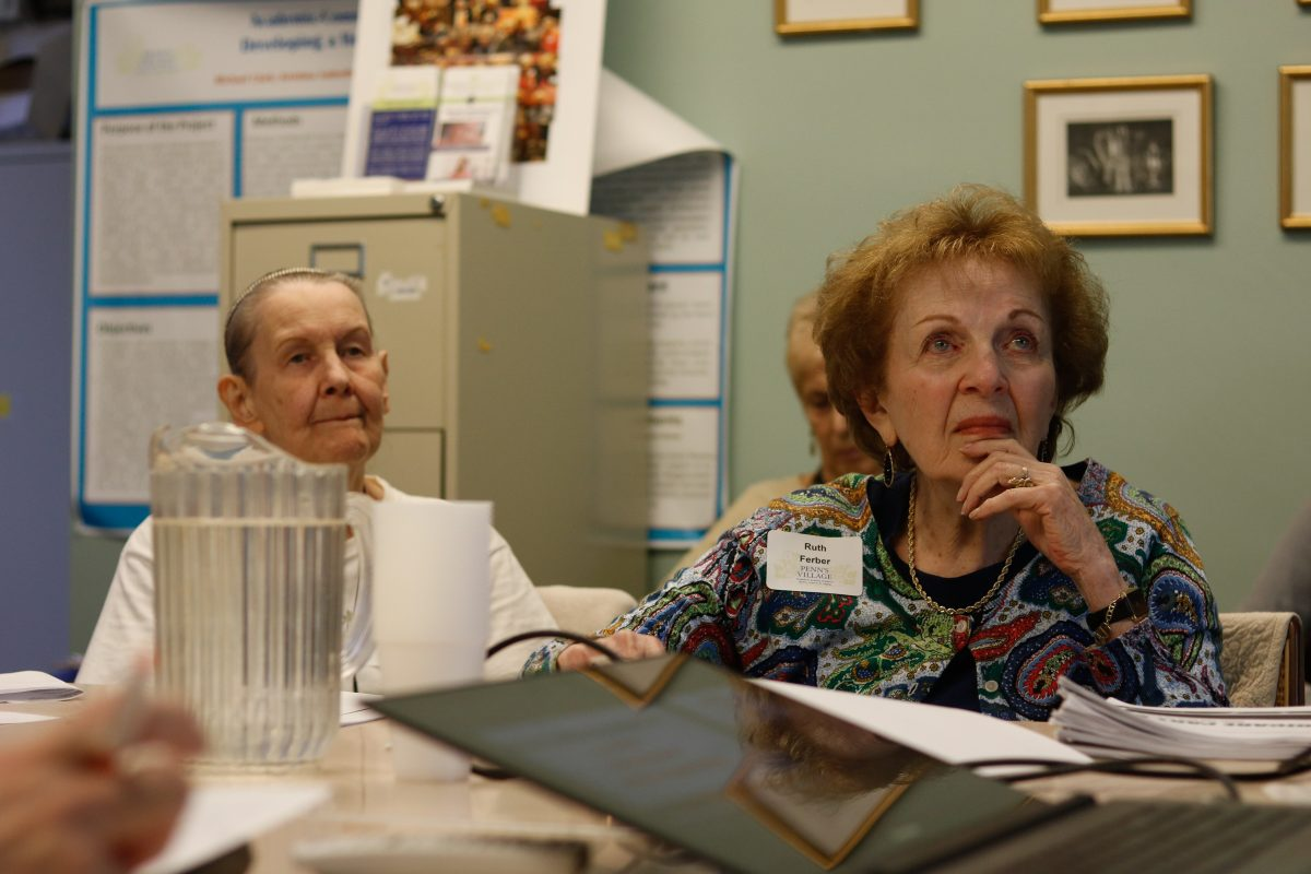 Penn's Village members Evelyn Kobler, left, and Ruth Ferber, right, listen as Richard Salkowitz  talks about Medicare Part D.