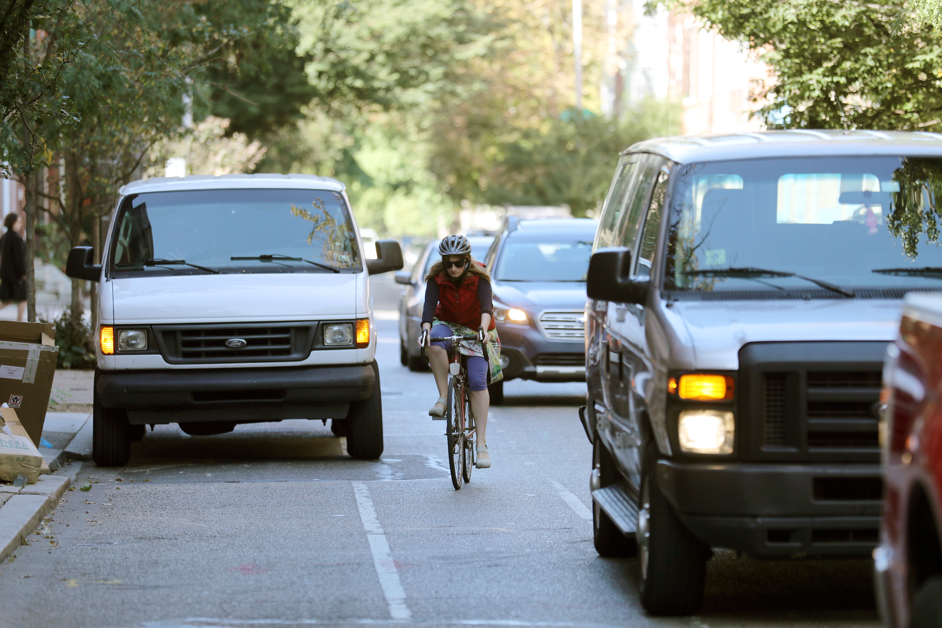 A bicyclist weaving into traffic to avoid a parked van in the bike lane on on Pine Street.. DAVID SWANSON / Staff Photographer