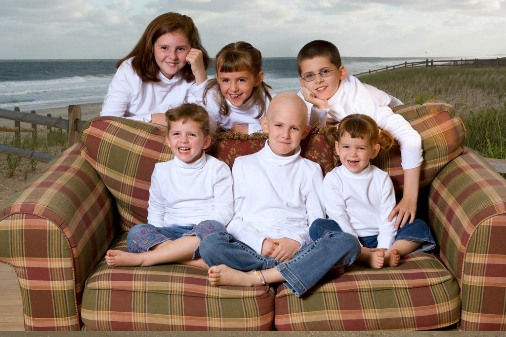 The O'Brien children gather around Catie (front, center). In between radiation and chemotherapy, Catie came home from St Jude Children's Research Hospital and the family spent a few days at the beach together.