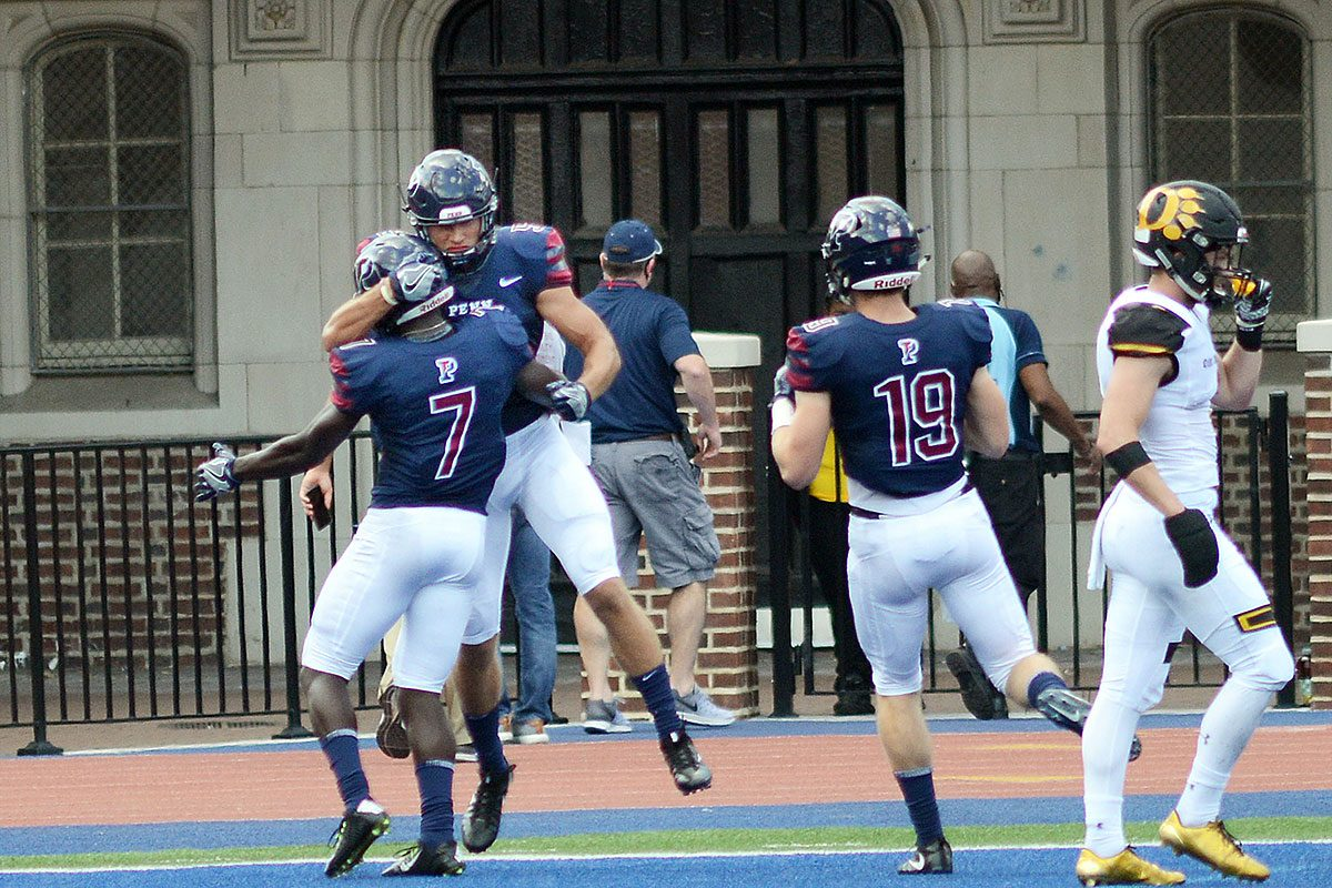 Penn's Christian Pearson (7) and Justin Watson (5) celebrate a touchdown in the second quarter Saturday, September 16, 2017 at Franklin Field in Philadelphia, Pennsylvania.