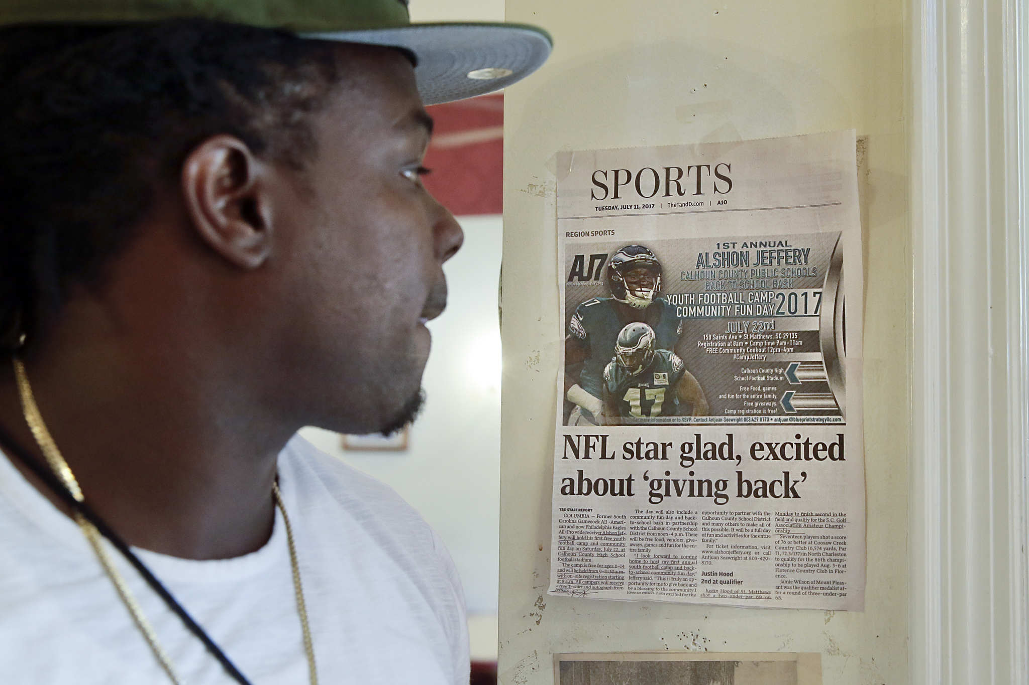 Charles Ben, Eagles wide receiver Alshon Jeffery´s older brother, pauses to look at a newspaper article about his brother that hangs by the door at the Town and Country Restaurant in downtown St. Matthews, South Carolina.