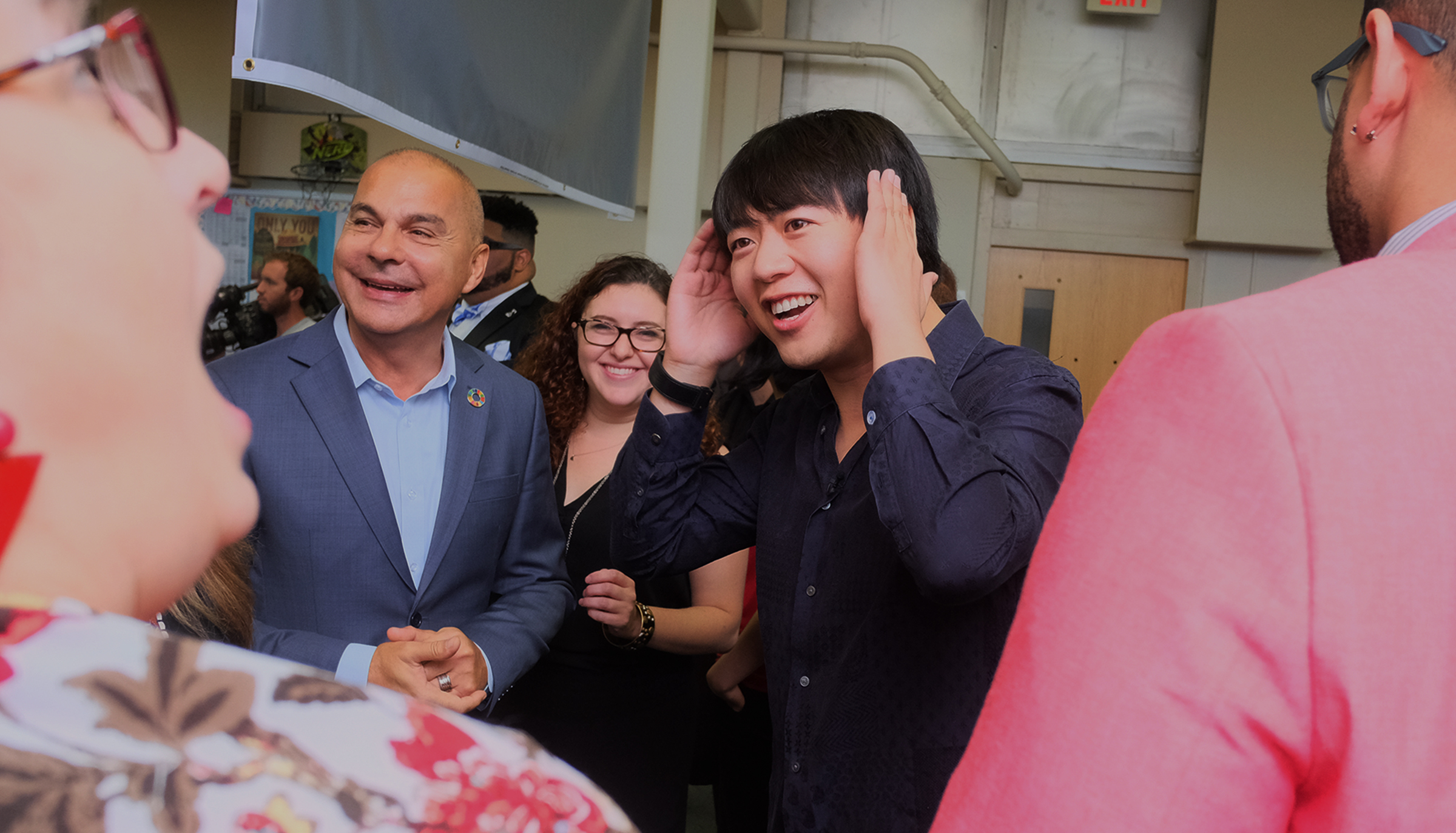 Lang Lang reacts to the enthusiastic reception he received as he entered the music lab at Thomas Holme Elementary school.