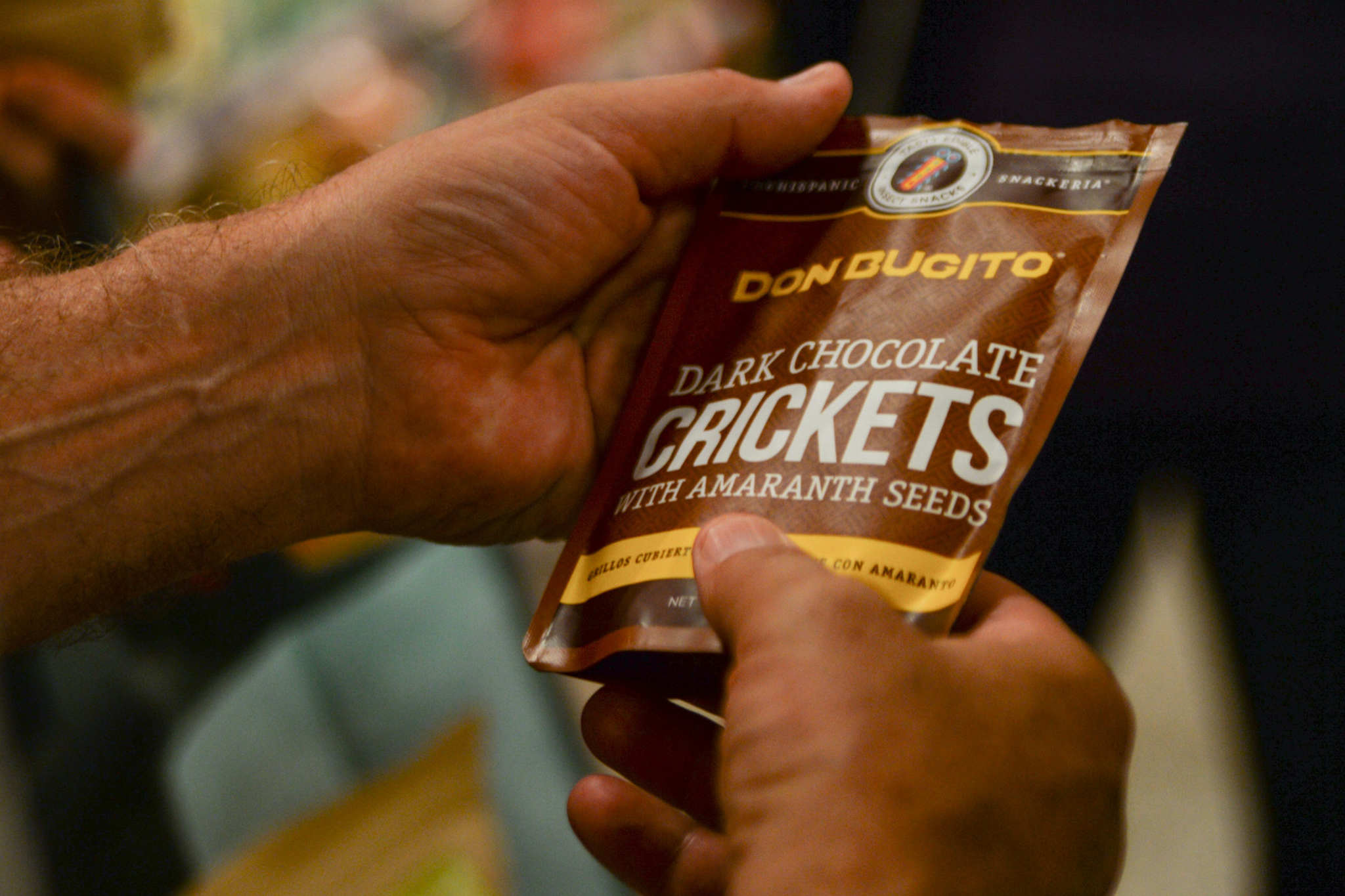 Jim Hughes examines a pack of Chocolate Crickets at MOM´s Organic Market in Center City.