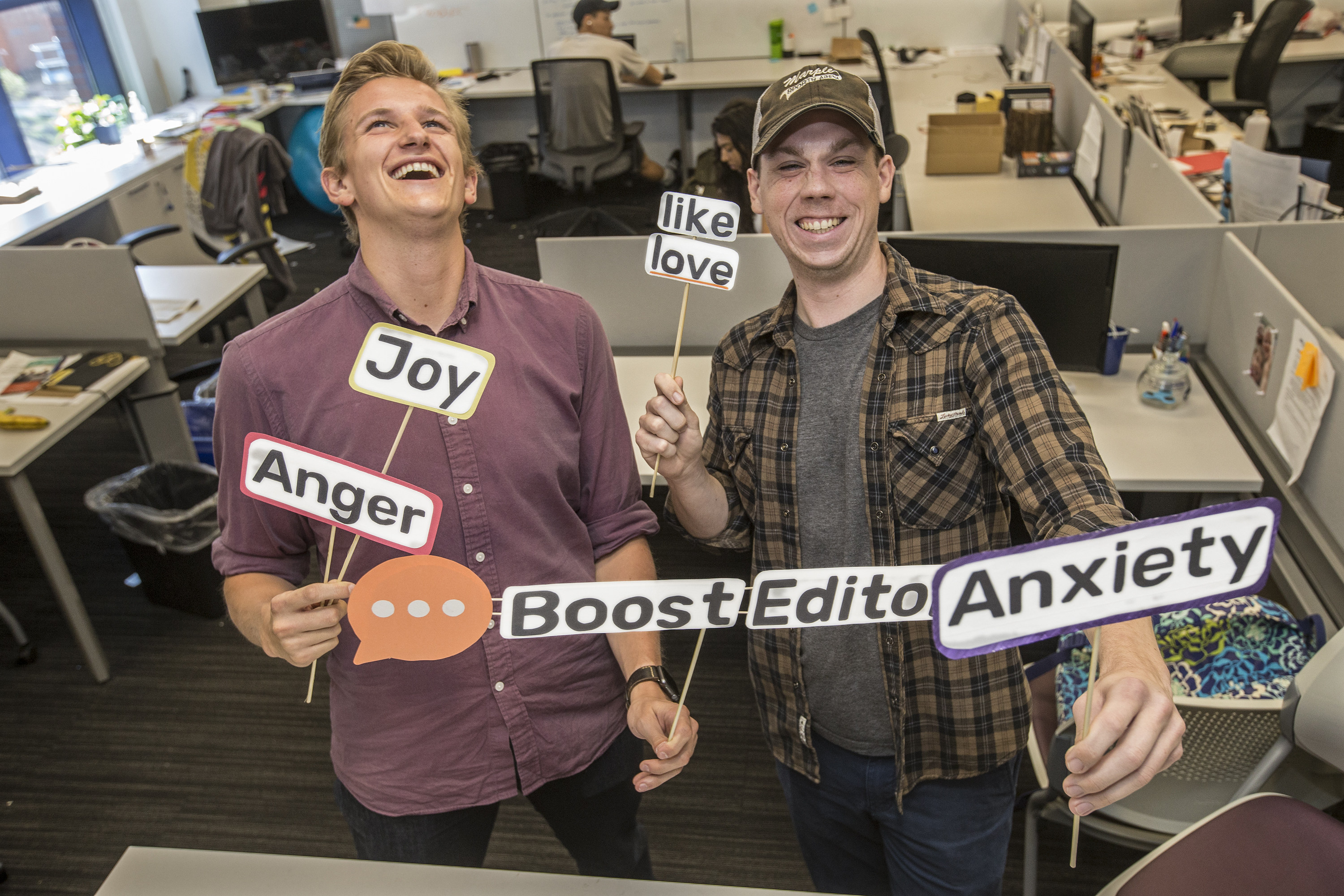 Ethan Bresnahan (left) and Jeff Nowak, two of the cofounders of Boost Linguistics, credit Zeewy with helping build their brand. Their software targets emotionally charged words and suggests more-effective alternatives for marketing materials.