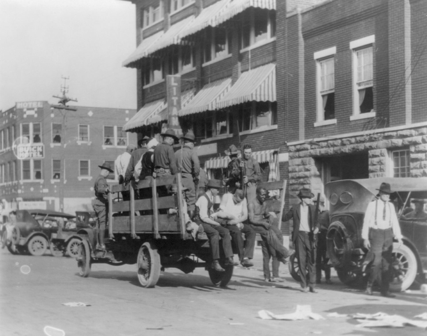 A truck near Litan Hotel carries soldiers and African Americans during Tulsa, Okla., race riot in 1921.