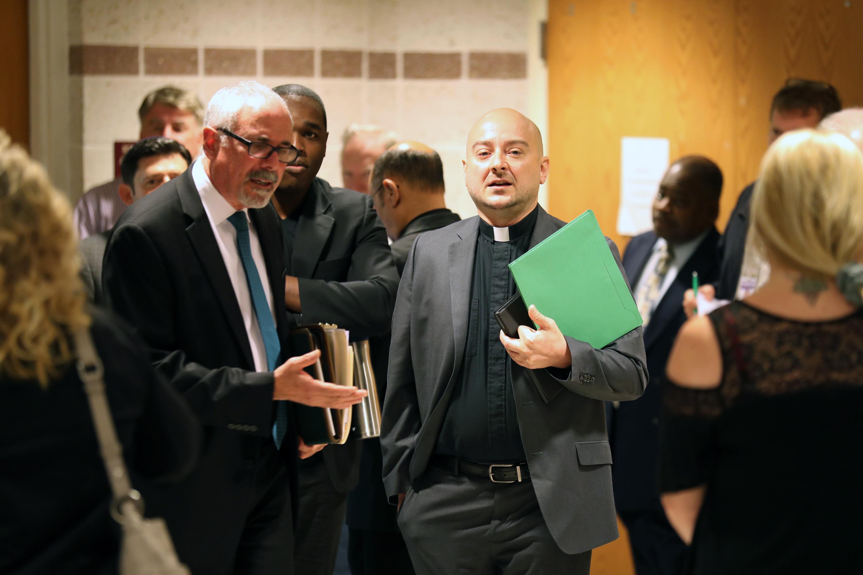 Steven A. Traub, (L) Cherry Hill lawyer representing Joseph Baird.) talks with the Rev. Ryan Paetzold.