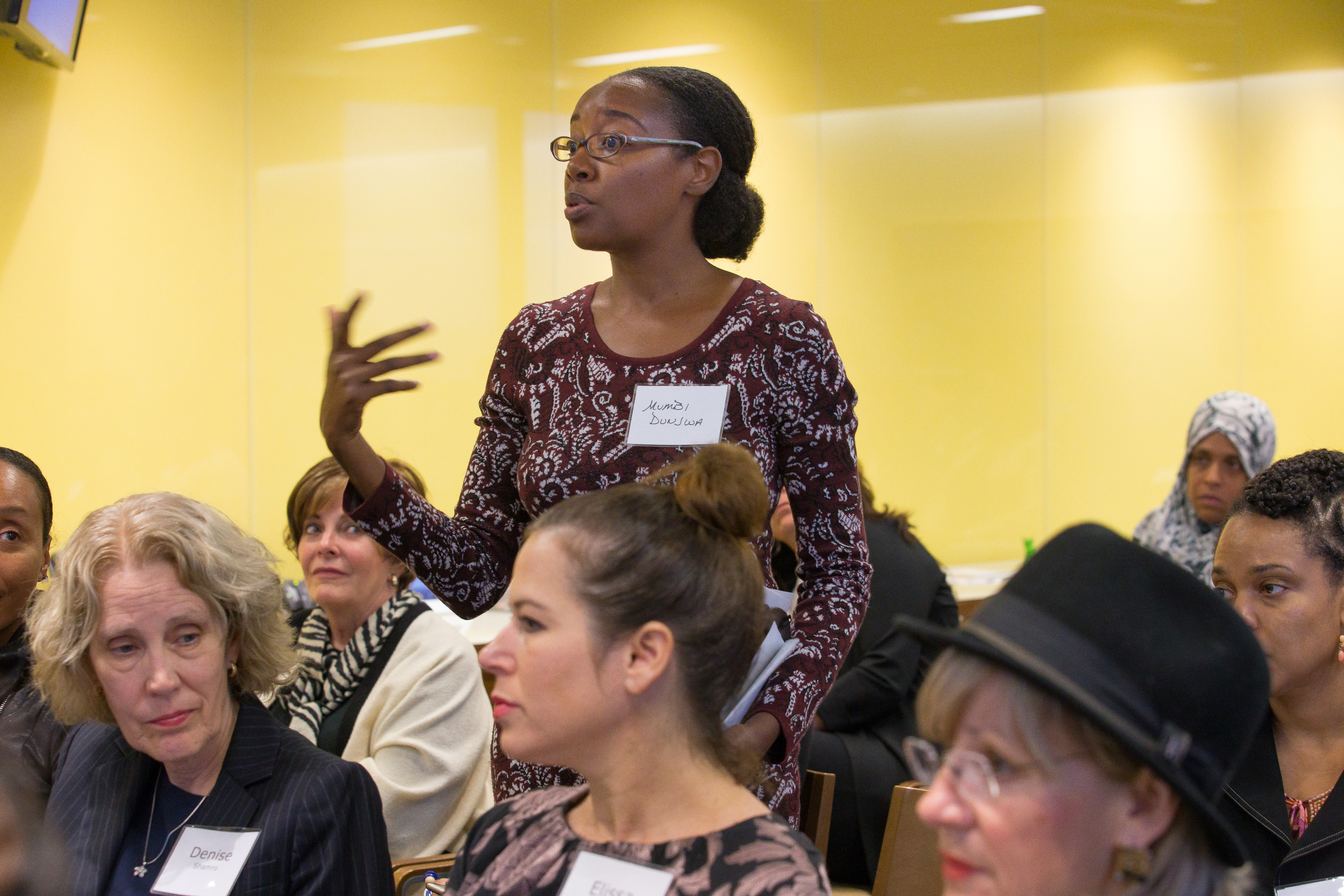 Mumbi Dunjwa, founder and CEO of Naturaz hair care, asks a question during the Women Raising Capital conference, a rare female-focused event in the world of start-up financing. JESSICA GRIFFIN / Staff Photographer .