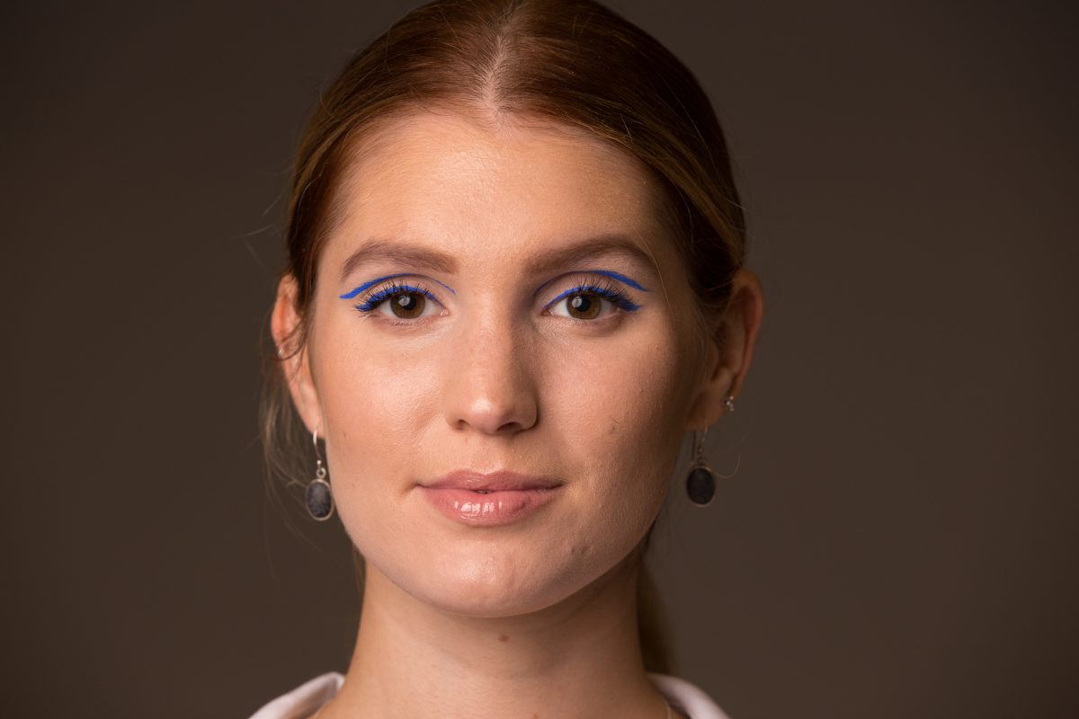 Kristen Sokac models the floating crease eyeliner look in purple. Makeup courtesy of Rebecca Gawlick of Dream Spa & Waxing in Cherry Hill.