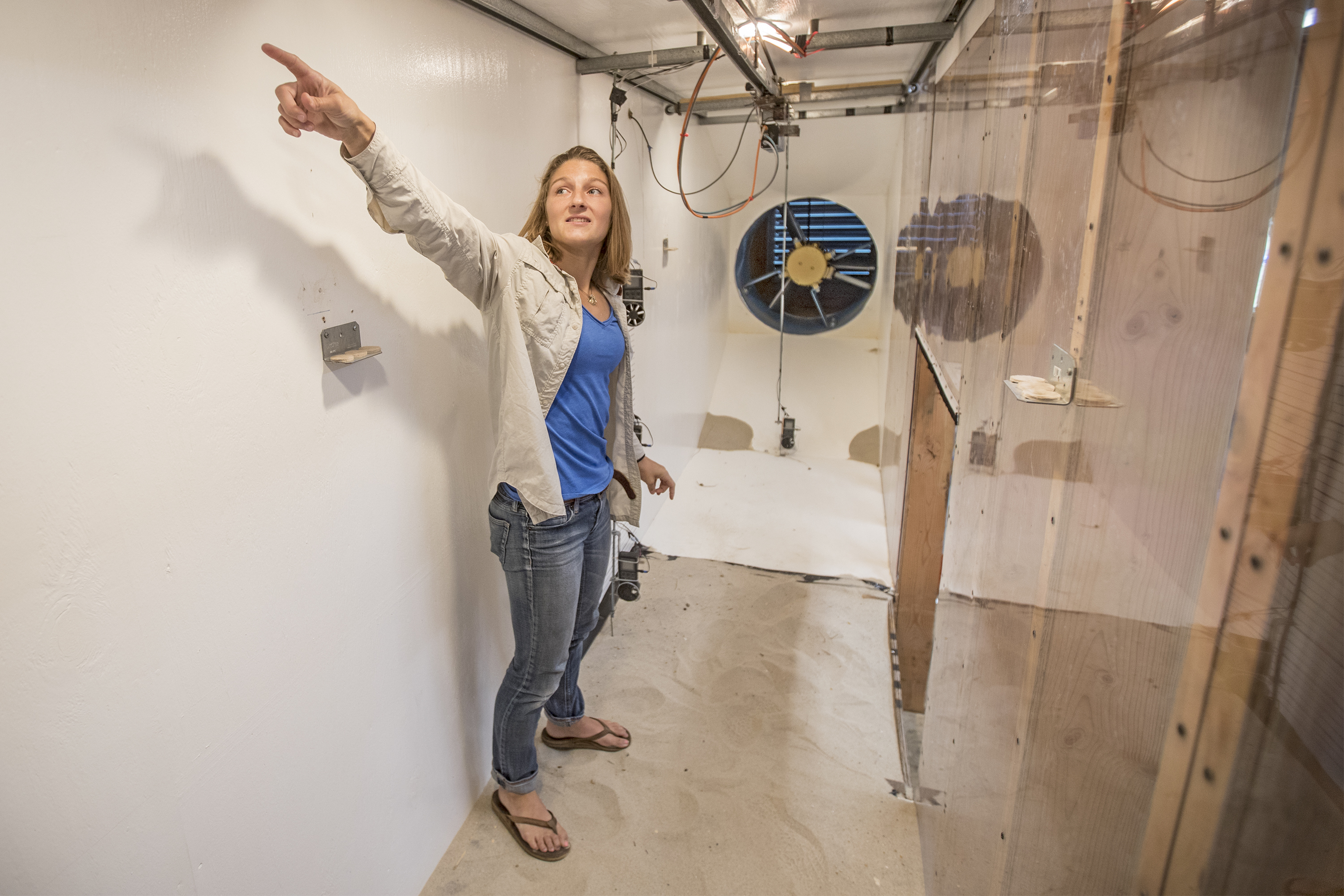 Bianca Charbonneau, a Penn doctorate student, stands inside the wind tunnel she had built at the Ocean County Vocational Technical School in Waretown, N.J. with the money she got from a grant from the Army Corp of Engineers.