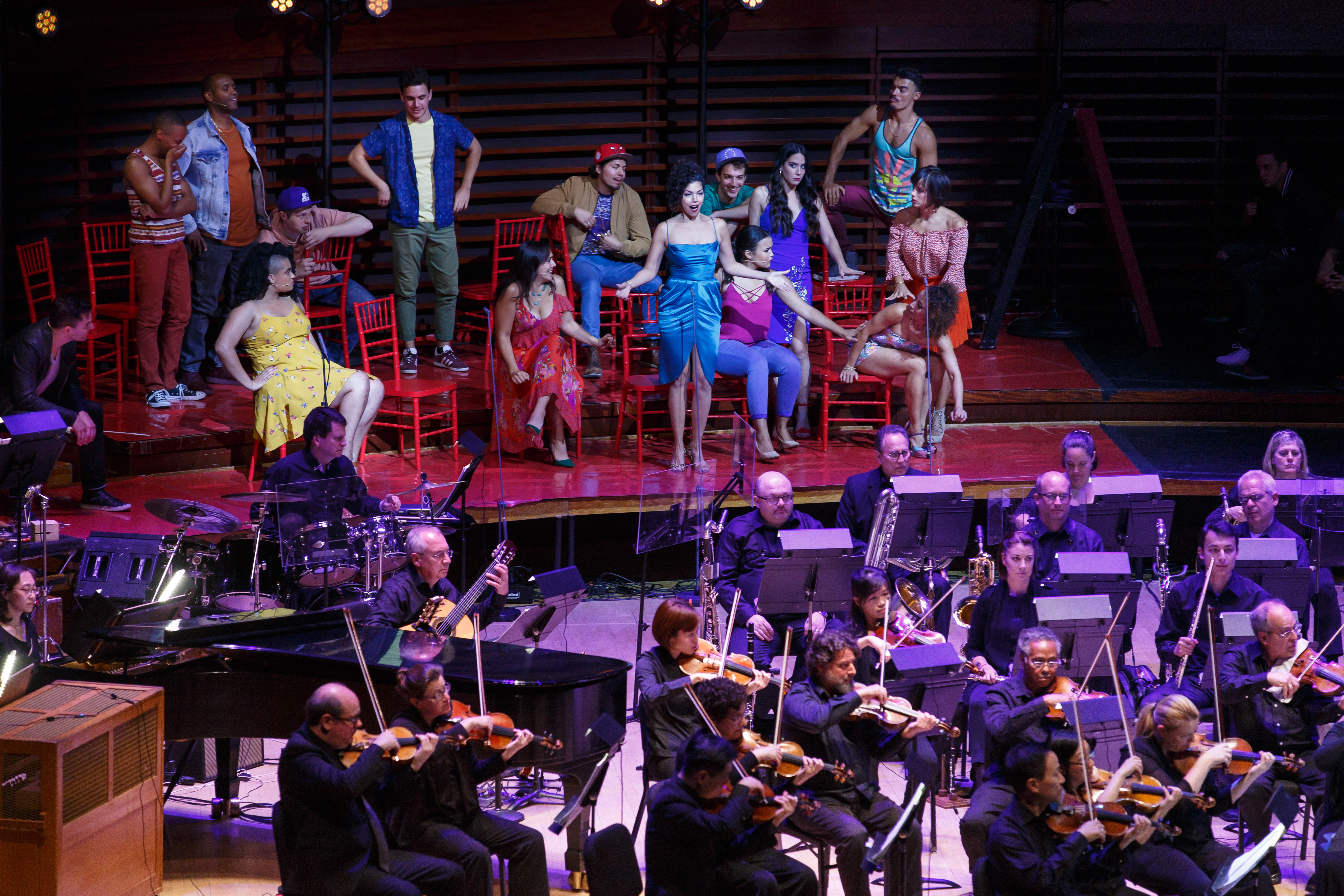 Isabel Santiago (center, in turquoise gown) as Anita in the Philadelphia Orchestra´s semi-staged production of Leonard Bernstein´s West Side Story, Thursday Oct. 12, 2017. (PHILDELPHIA ORCHESTRA)